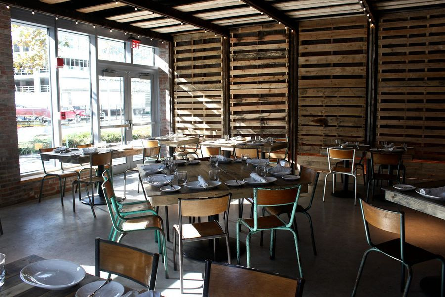 Restaurant interior full of wood beams