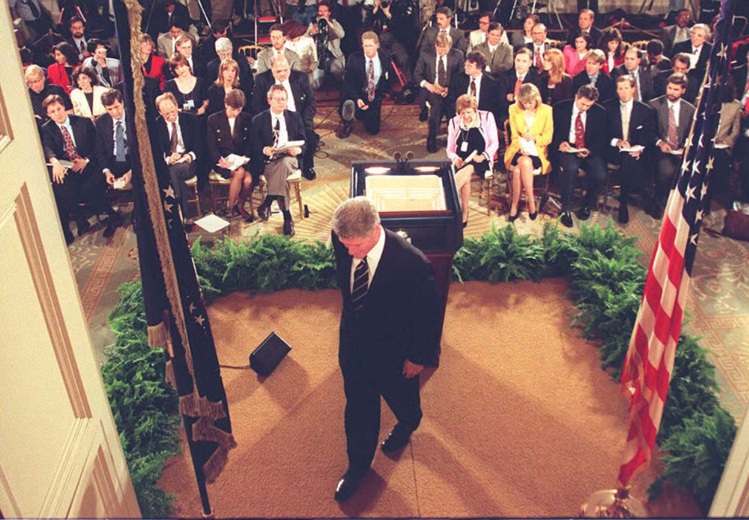 Bill Clinton leaves a April 18, 1996, press conference where he challenged Congress to give him welfare reform legislation.