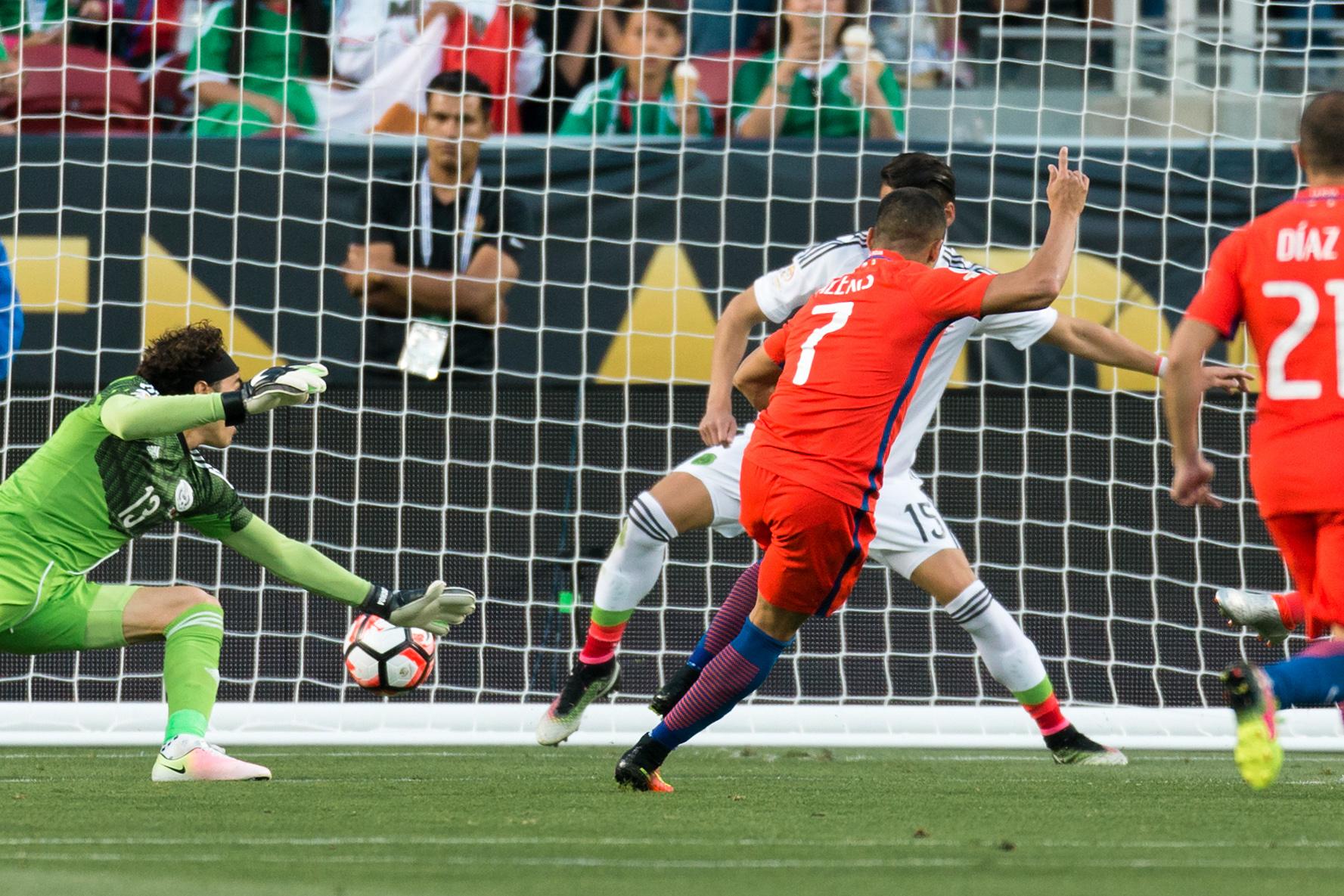 Alexis Sanchez scoring one of seven goals against Mexico.