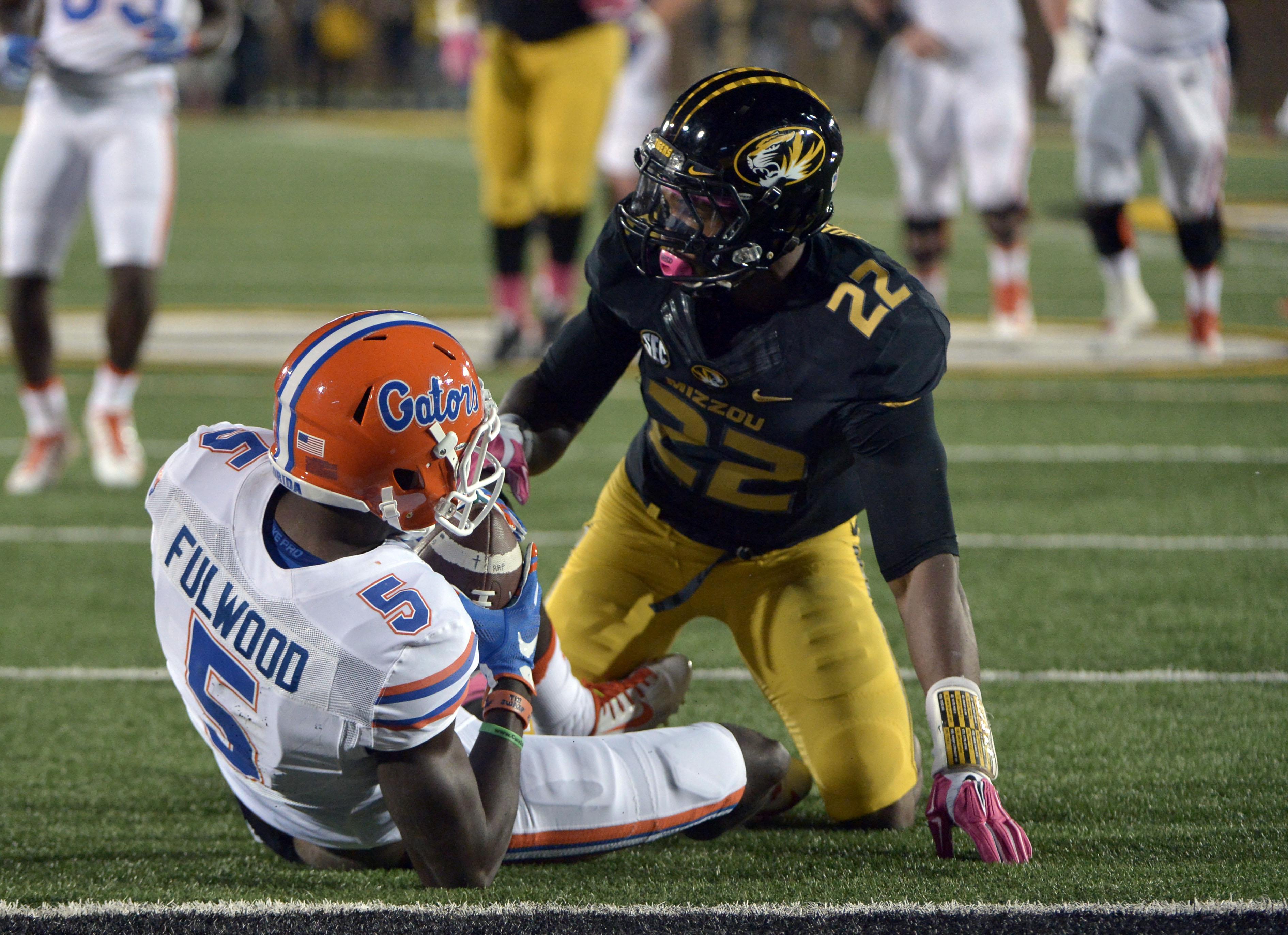 Anthony Sherrils, kneeling over his prey