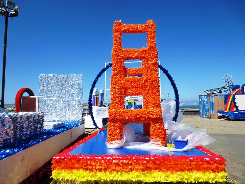 A picture of a Golden Gate Bridge themed parade float.