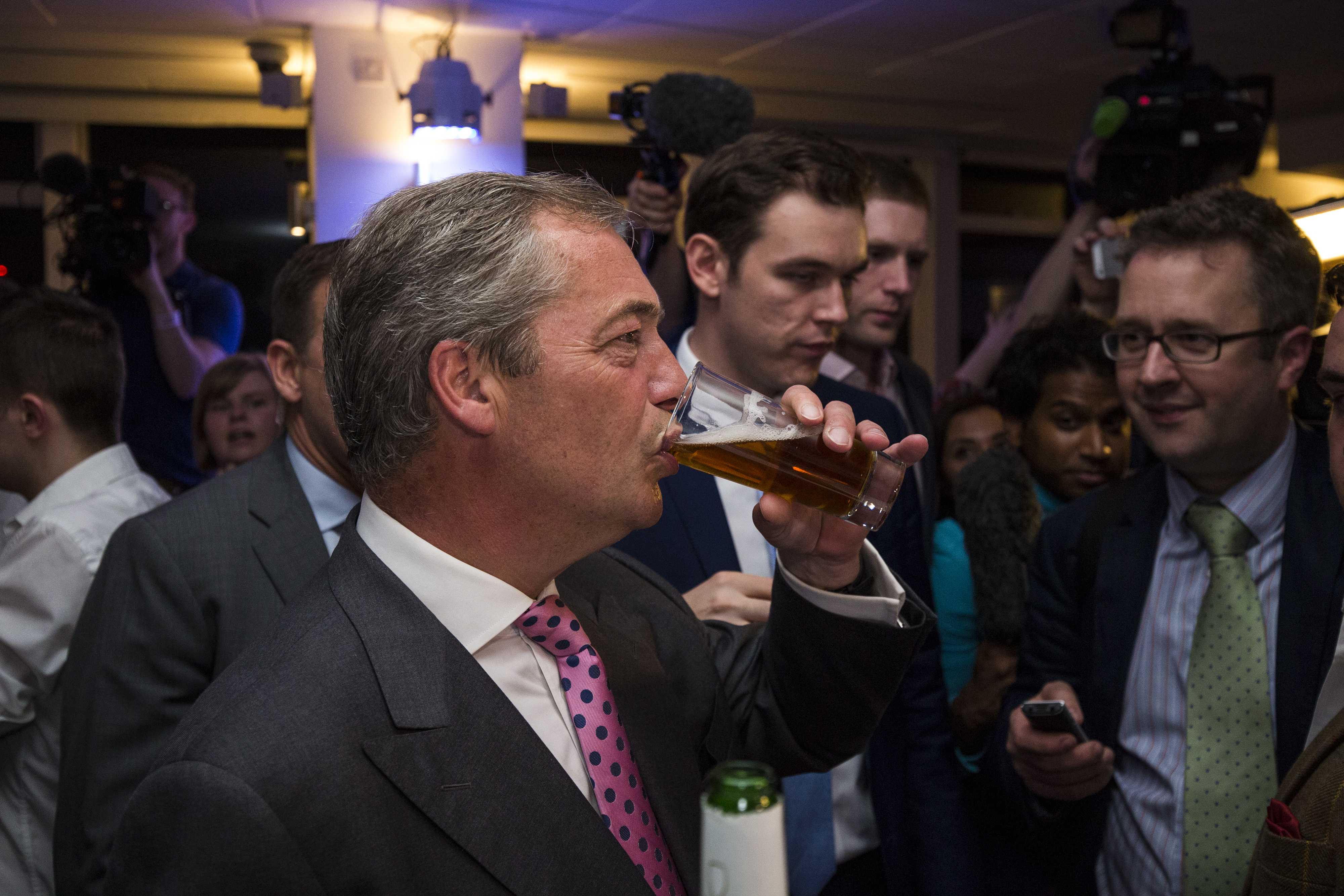 """UK Independence Party Leader Nigel Farage has a drink at the """"Leave"""" campaign's referendum party at Millbank Tower on June 23, 2016, in London, England."""