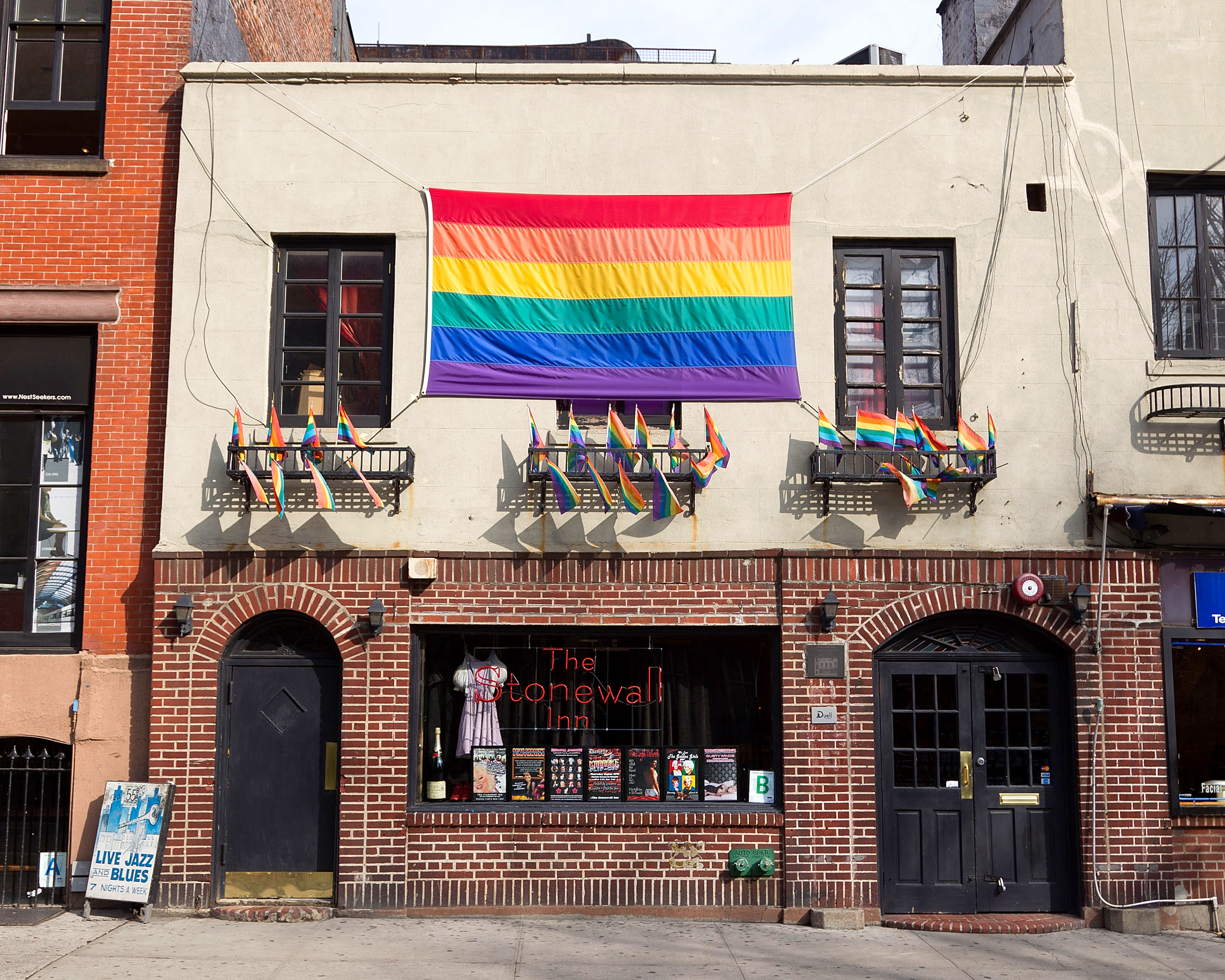 New York City's Stonewall Inn decorated with rainbow flags.