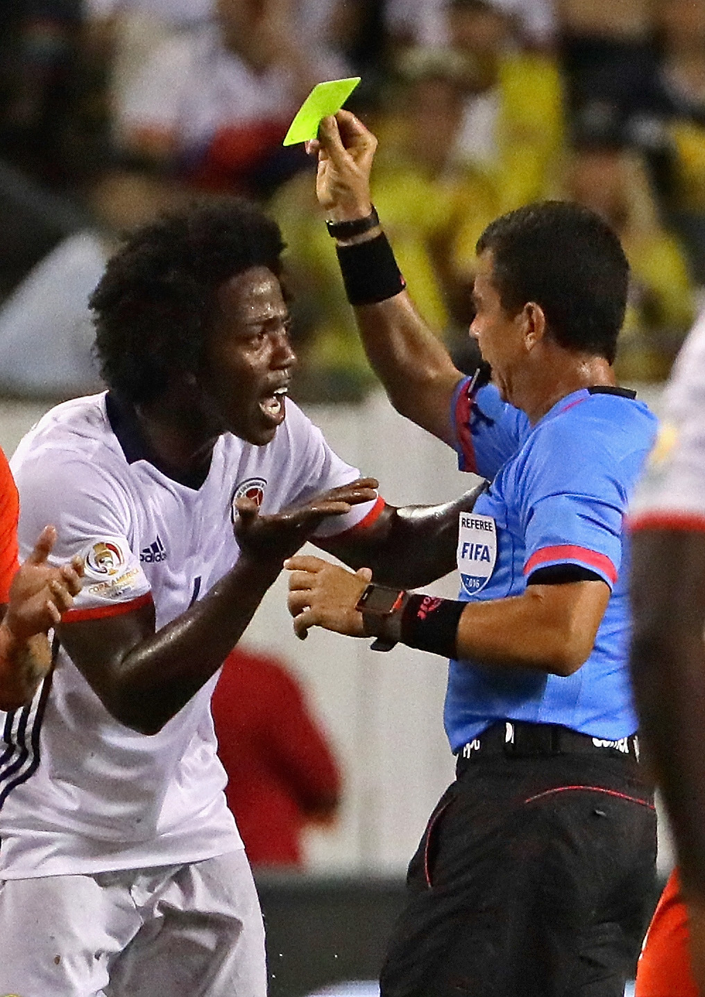 Colombia argues with referee Joel Aguilar Chicas after being given his second yellow card against Chile during a semi-final match in the 2016 Copa America Centernario at Soldier Field on June 22, 2016 in Chicago, Illinois. Chile defeated Colombia 2-0