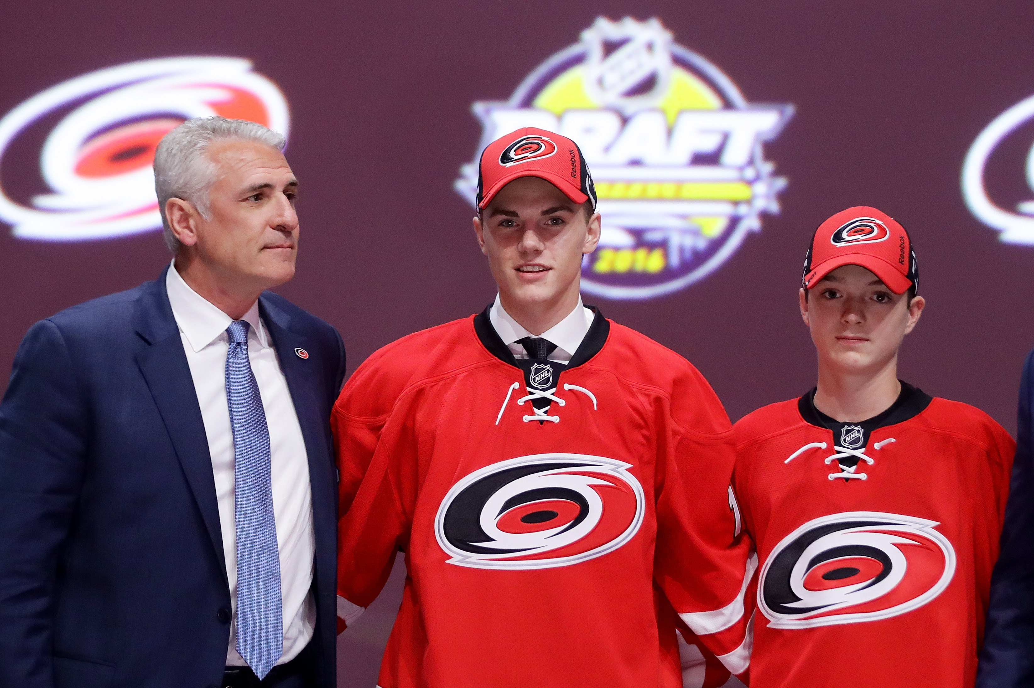 Ron Francis and Jake Bean after the Hurricanes selected the defenseman on Friday night
