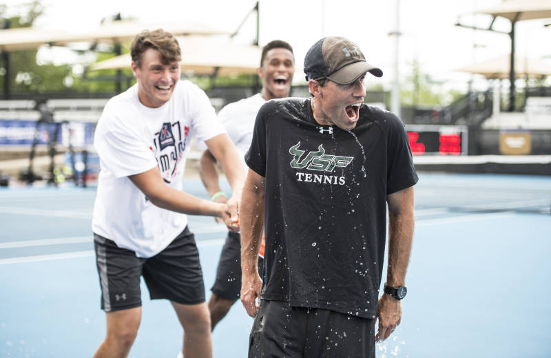 Matt Hill doused with water as he and his Bulls celebrate their third straight AAC Championship. Hill will leave to restart Arizona State's program.