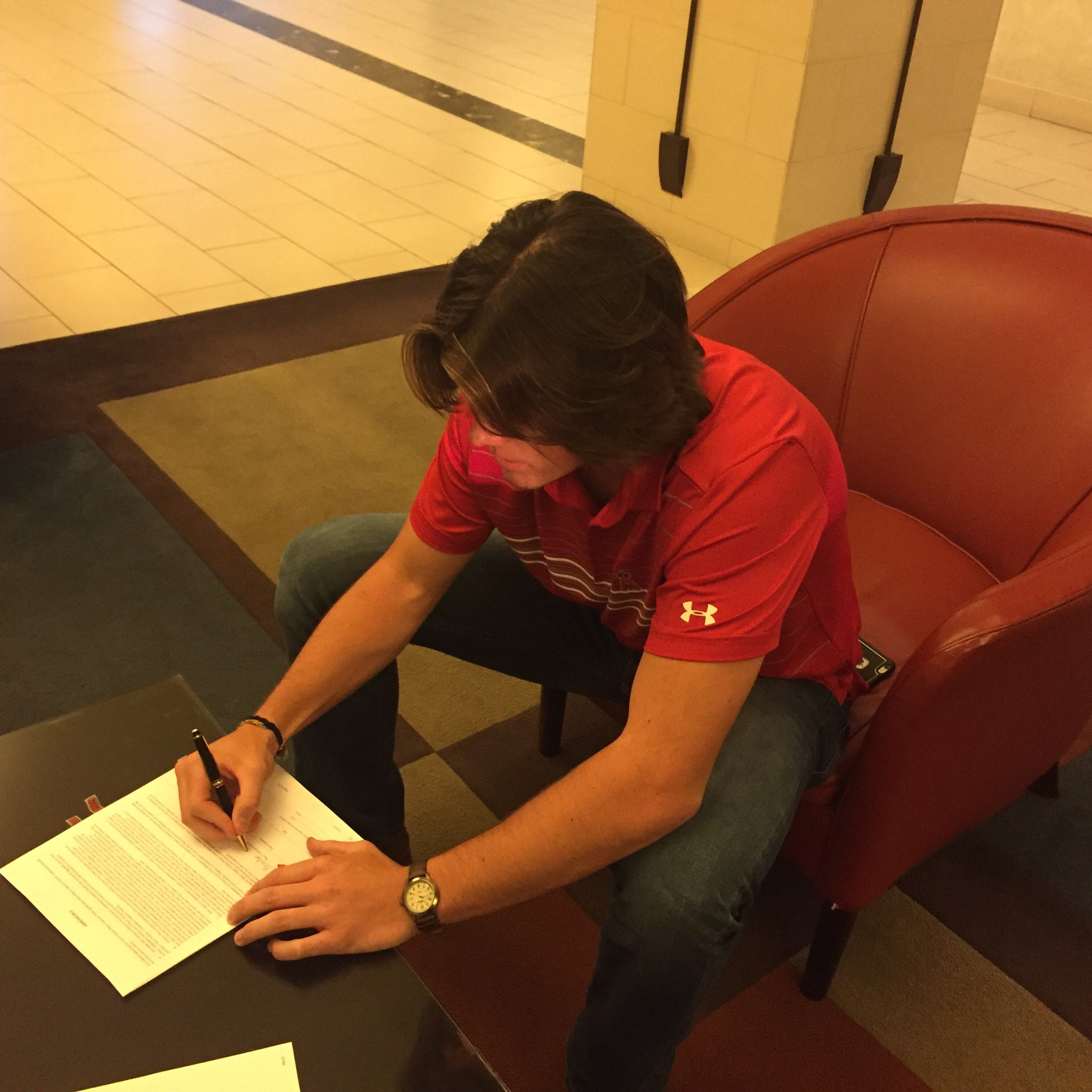 Marsh, a second round pick, puts ink to paper.