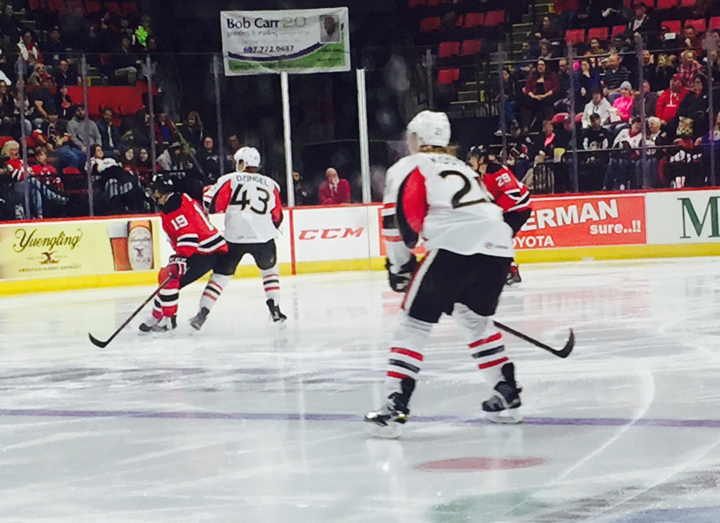Mike Kostka and Ryan Dzingel of the Binghamton Senators defend against the Albany Devils on October 10, 2015.