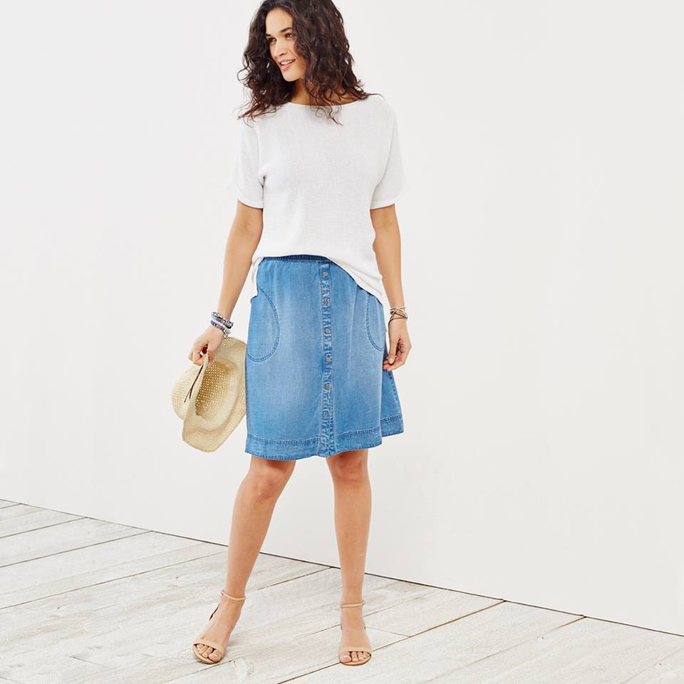 Woman wearing white loose tee tucked into a denim skirt by J.Jill