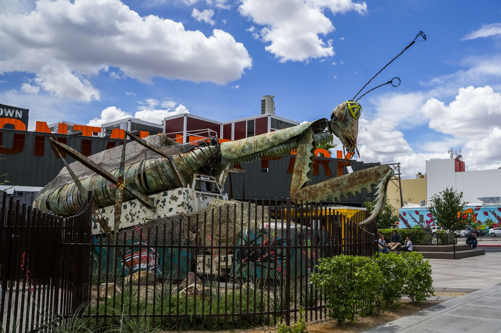 A metal preying mantis sculpture outside of Downtown Container Park