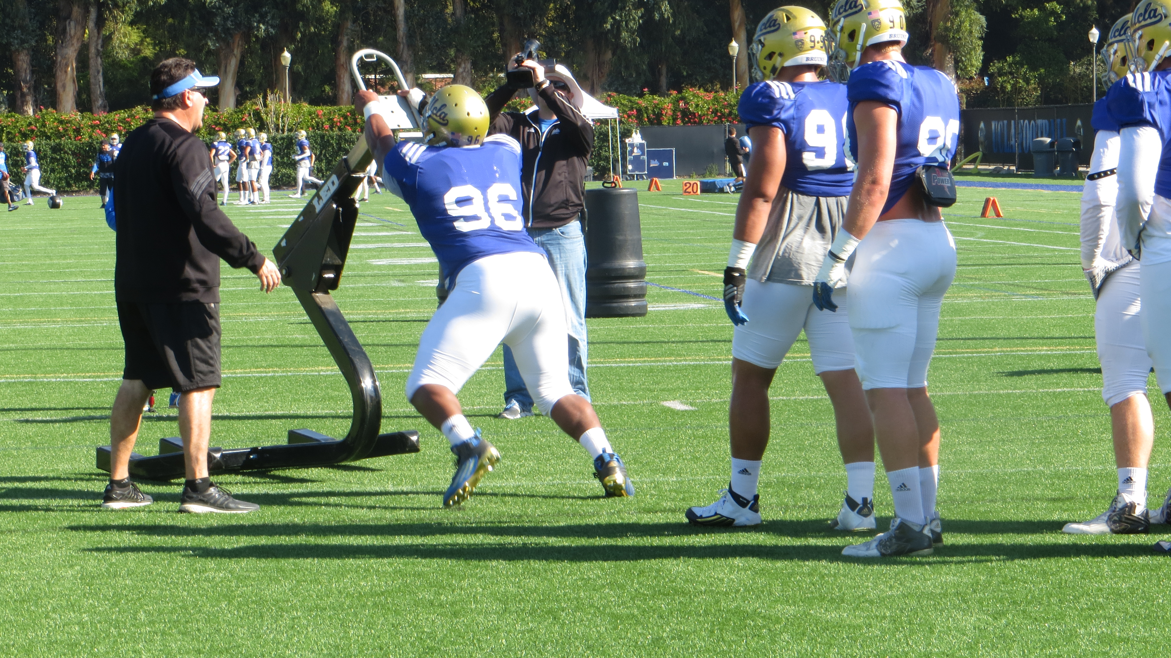 Defensiive lineman Eli Ankou hits the sled during Spring Practice.