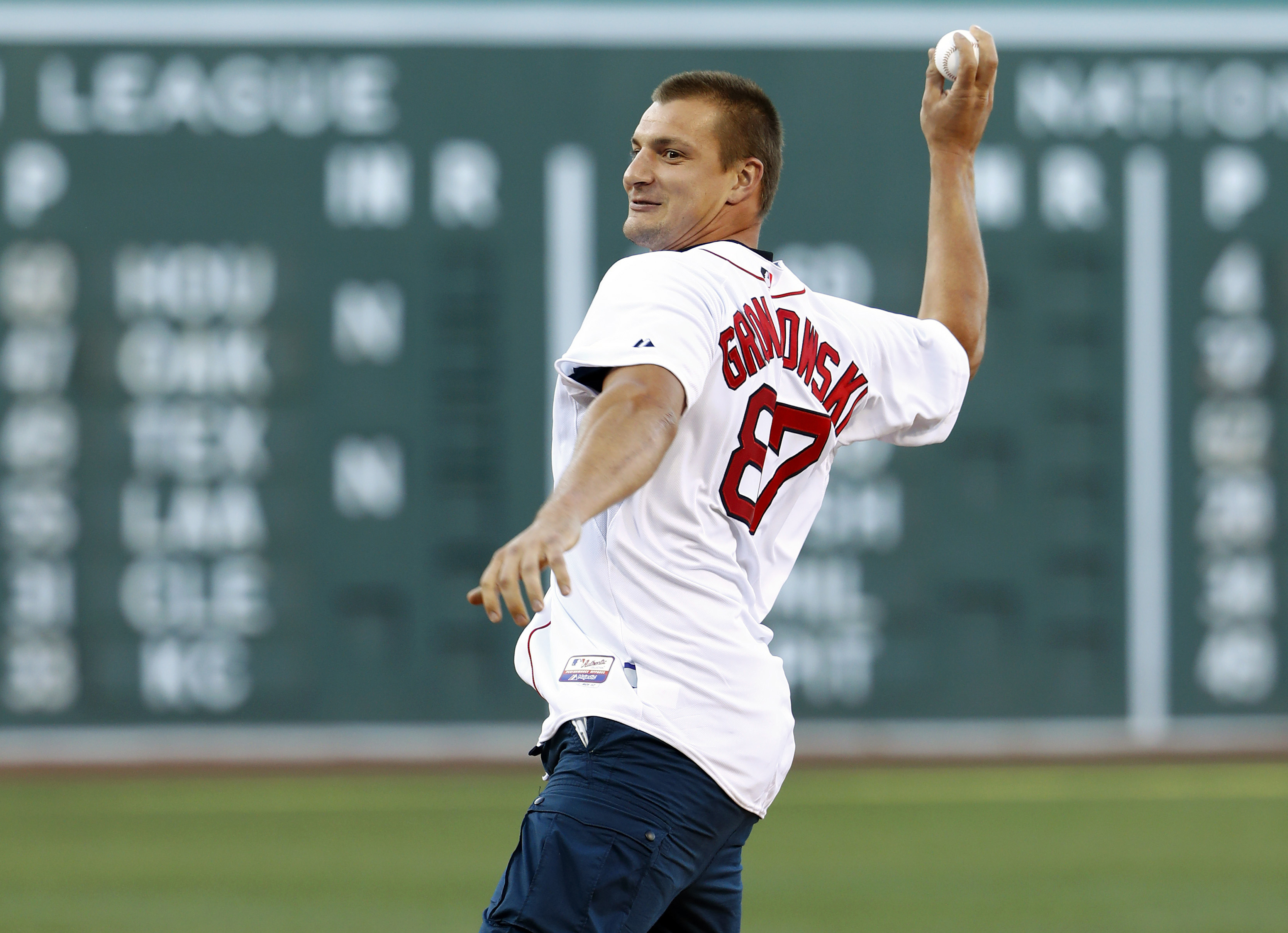 It is still baseball season, so here's a picture of the best tight end in the game throwing a baseball.