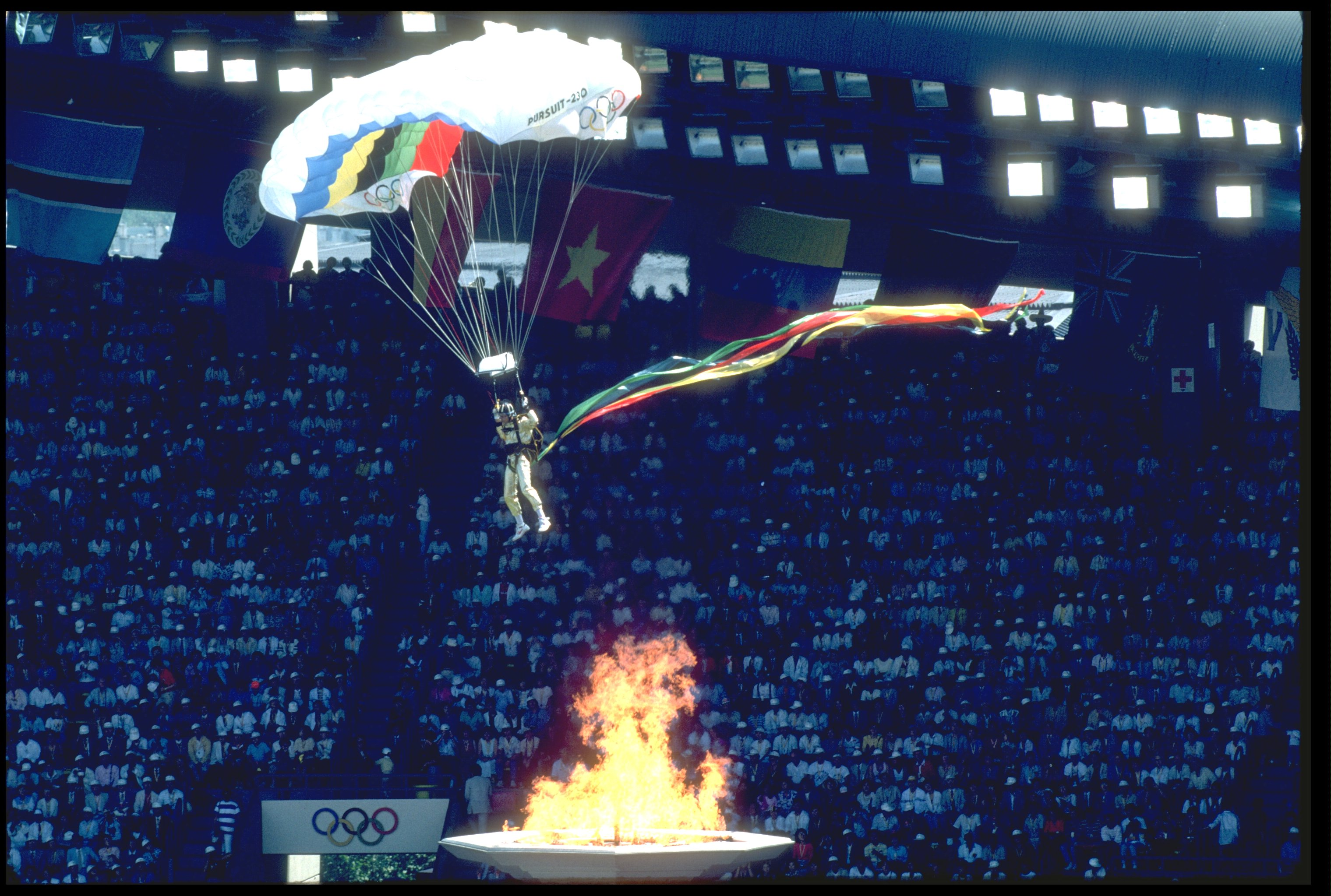 A skydiver parachutes into the Olympic stadium during the opening ceremony of the 1988 Seoul Olympics.