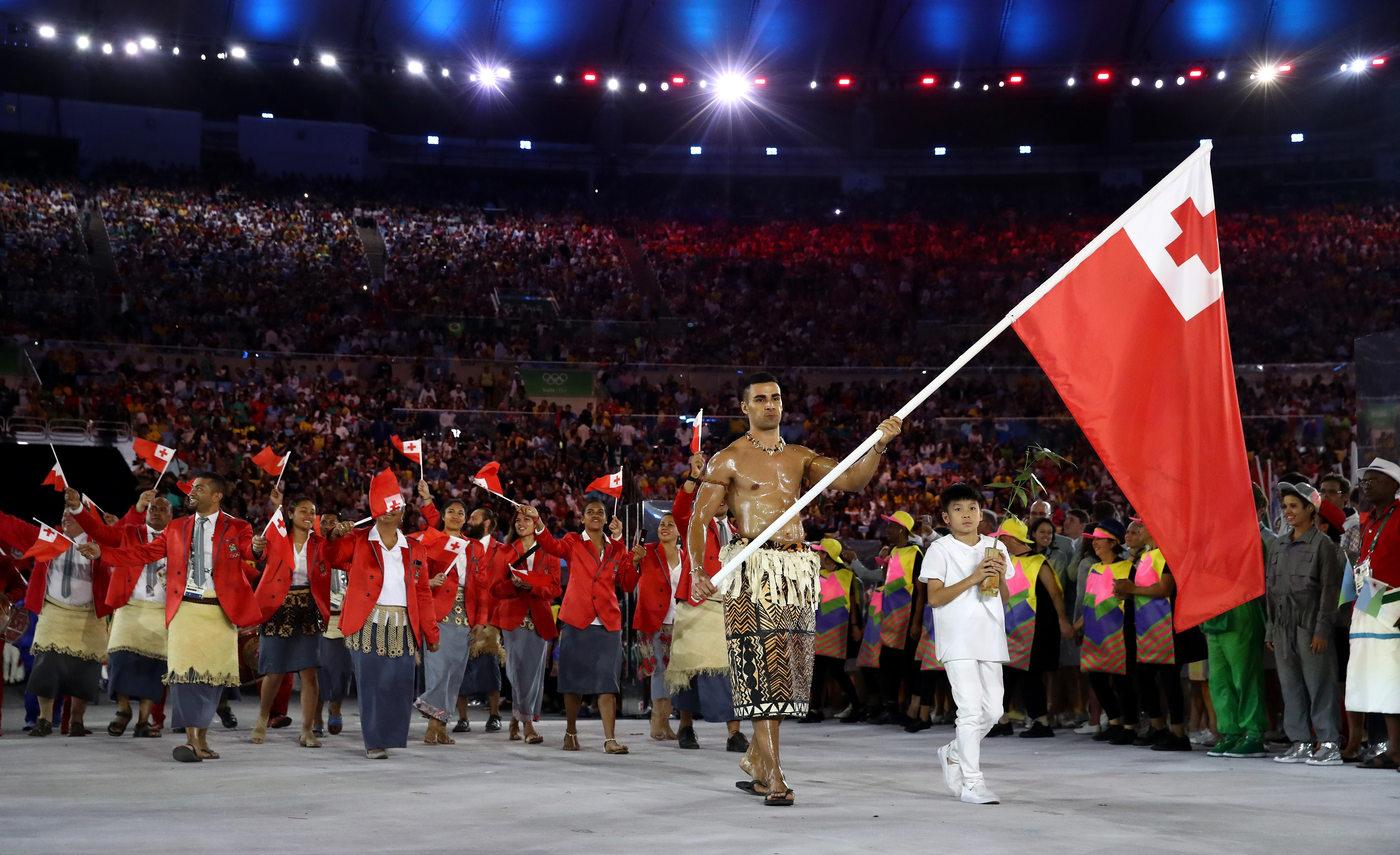 Pita Taufatofua of Tonga carries the flag during the Opening Ceremony of the Rio 2016 Olympic Games.