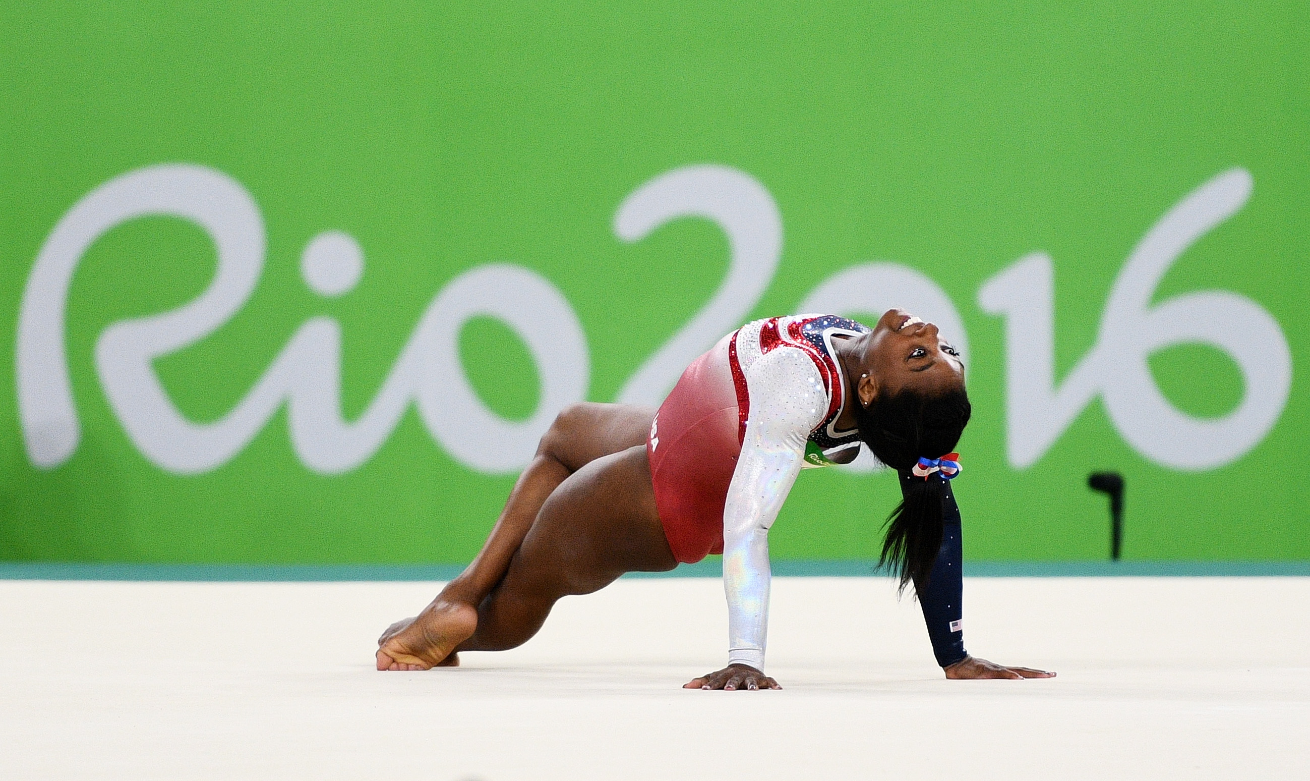 Simone Biles competes on the floor during the artistic gymnastics women's team final on day 4 of the Rio 2016 Olympic Games.