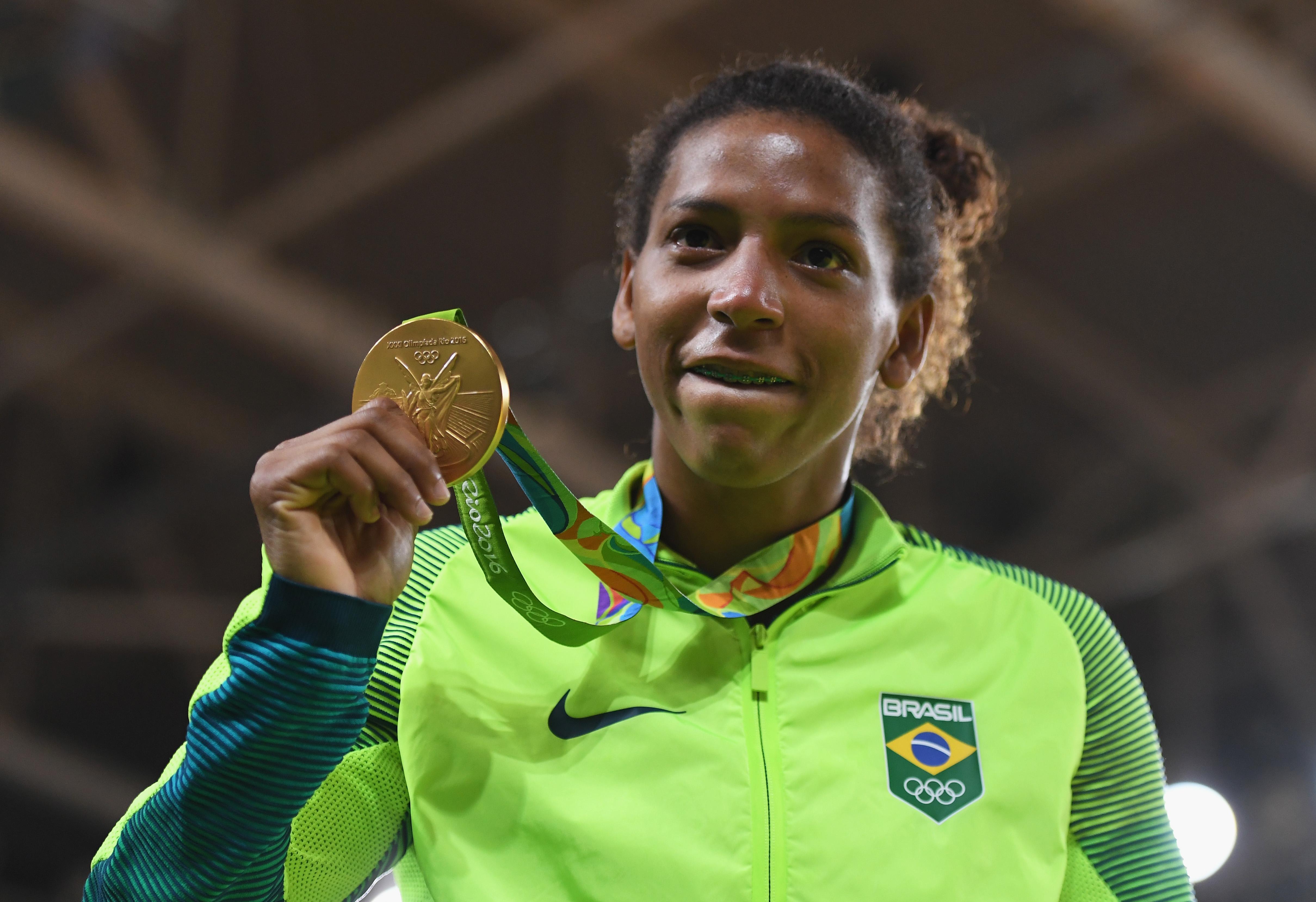 Rafaela Silva celebrates with her gold medal.