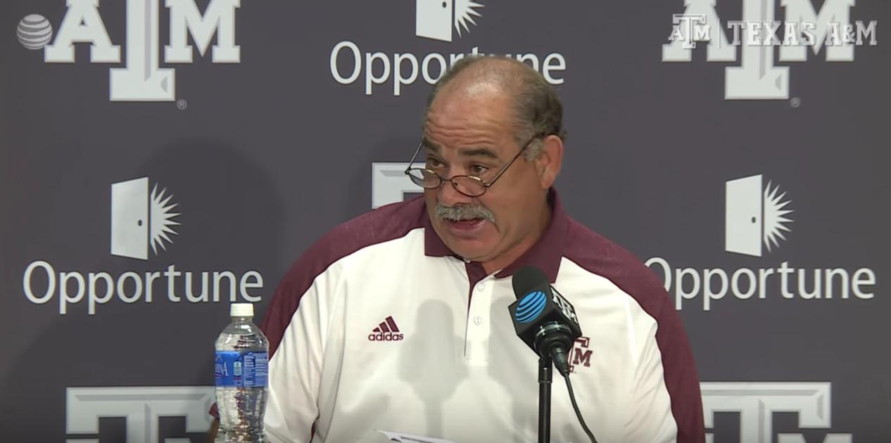 Coach John Chavis answers media questions