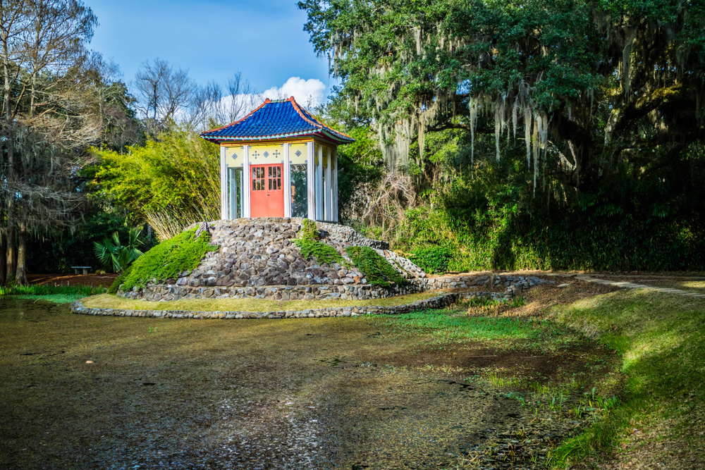 A small yellow pagoda in a lagoon shaded by live oaks at Avery Island