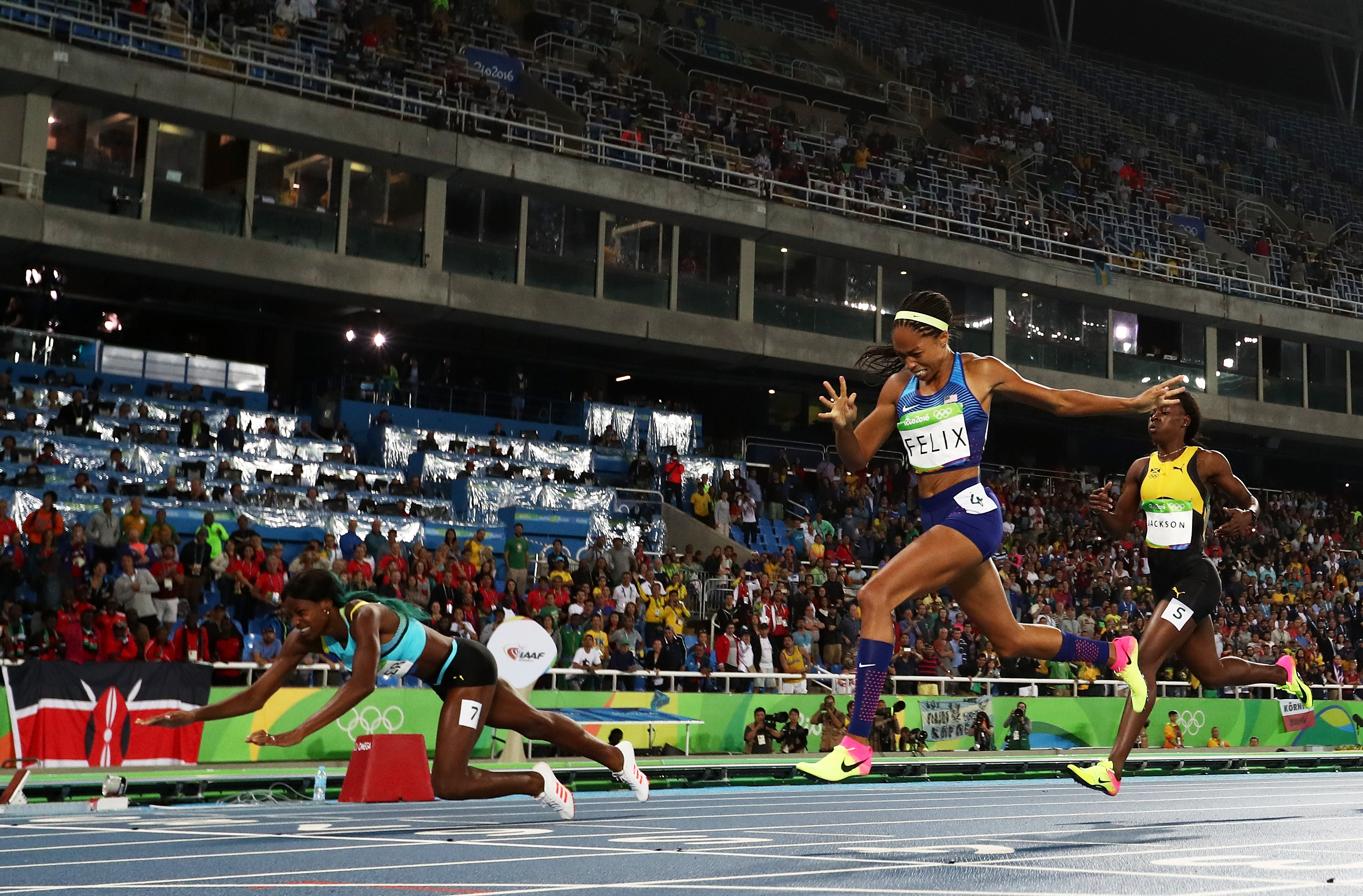 Shaunae Miller of the Bahamas (L) dives over the finish line to win the gold medal in the Women's 400 m final ahead of silver medalist Allyson Felix of the United States (C) and bronze medalist Shericka Jackson of Jamaica (R) on Day 10 of the Rio 2016 Olympic Games at the Olympic Stadium on August 15, 2016, in Rio de Janeiro, Brazil.