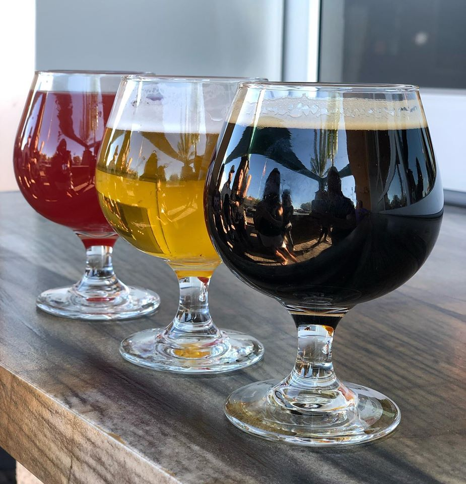 Three beers on a wooden bar