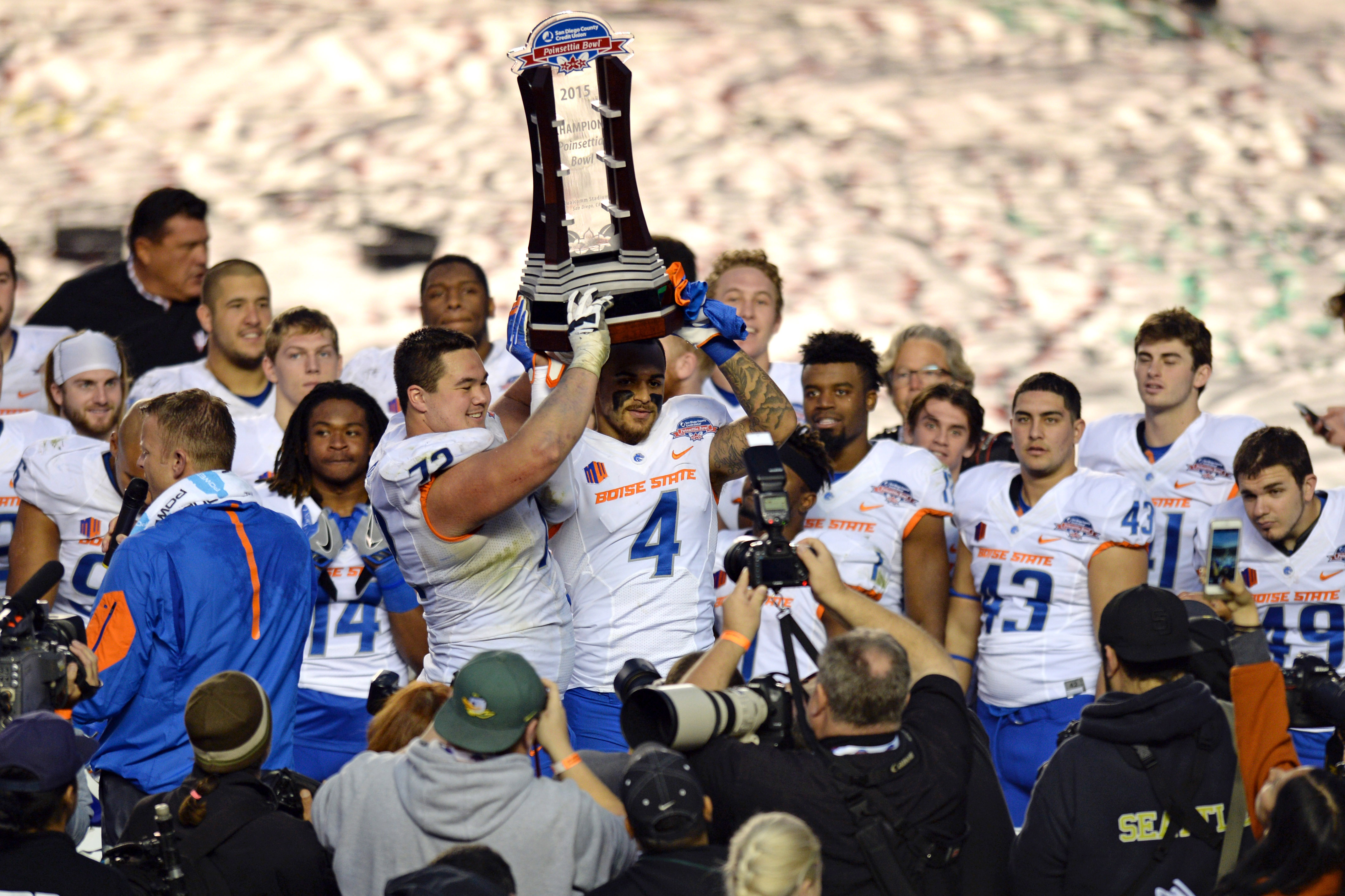 Dec 23, 2015; San Diego, CA, USA; Team captains Boise State Broncos offensive lineman Marcus Henry (72) and safety Darian Thompson (4) hold up the 2015 Poinsettia Bowl Trophy after beating Northern Illinois Huskies 55-7 at Qualcomm Stadium. Mandatory Credit: Jake Roth-USA TODAY Sports