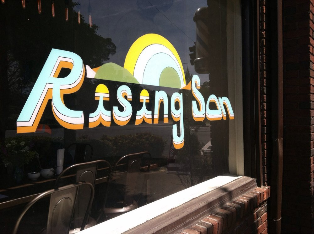 Exterior signage for Rising Son.