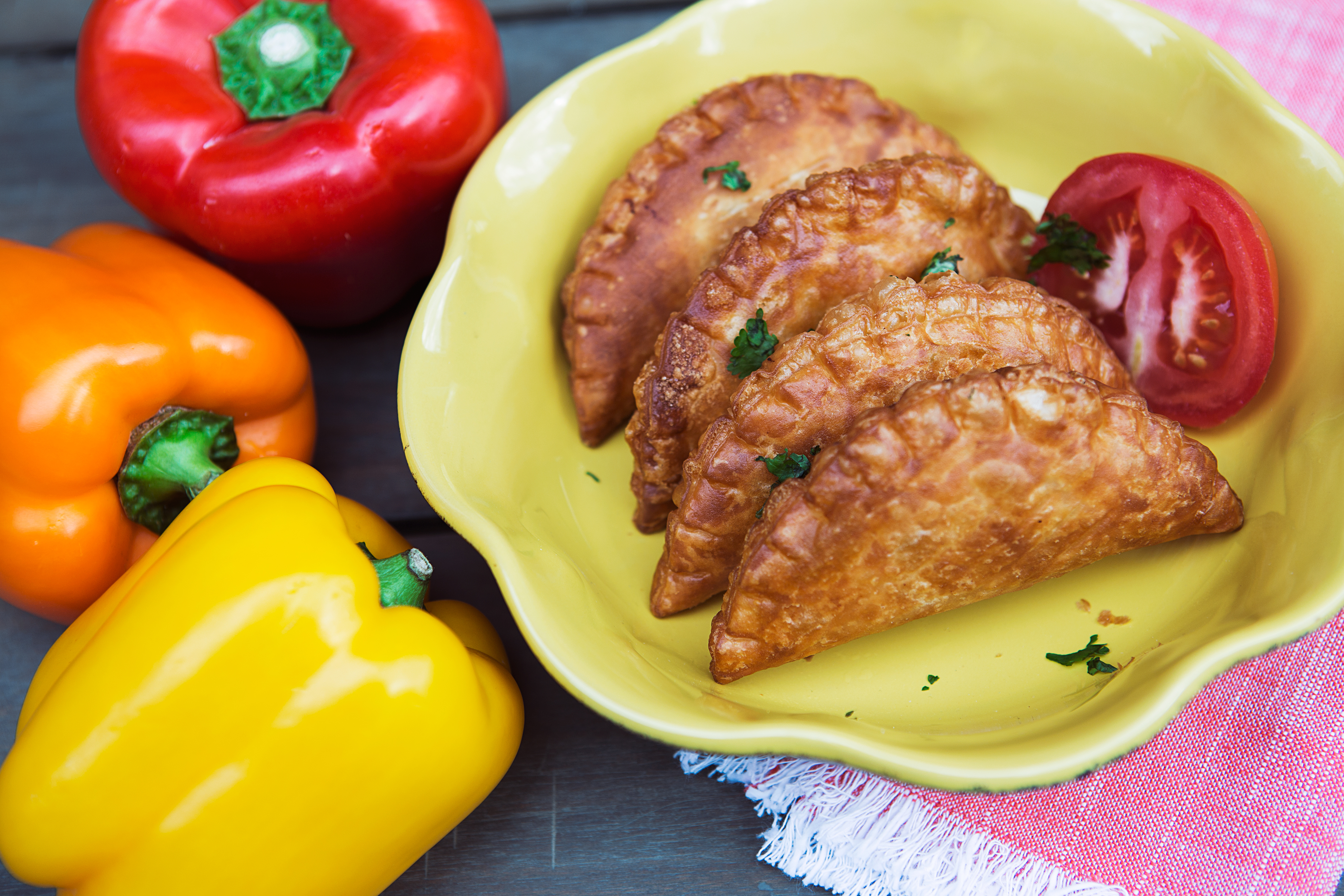 A plate of fried empanadas from Colada Shop