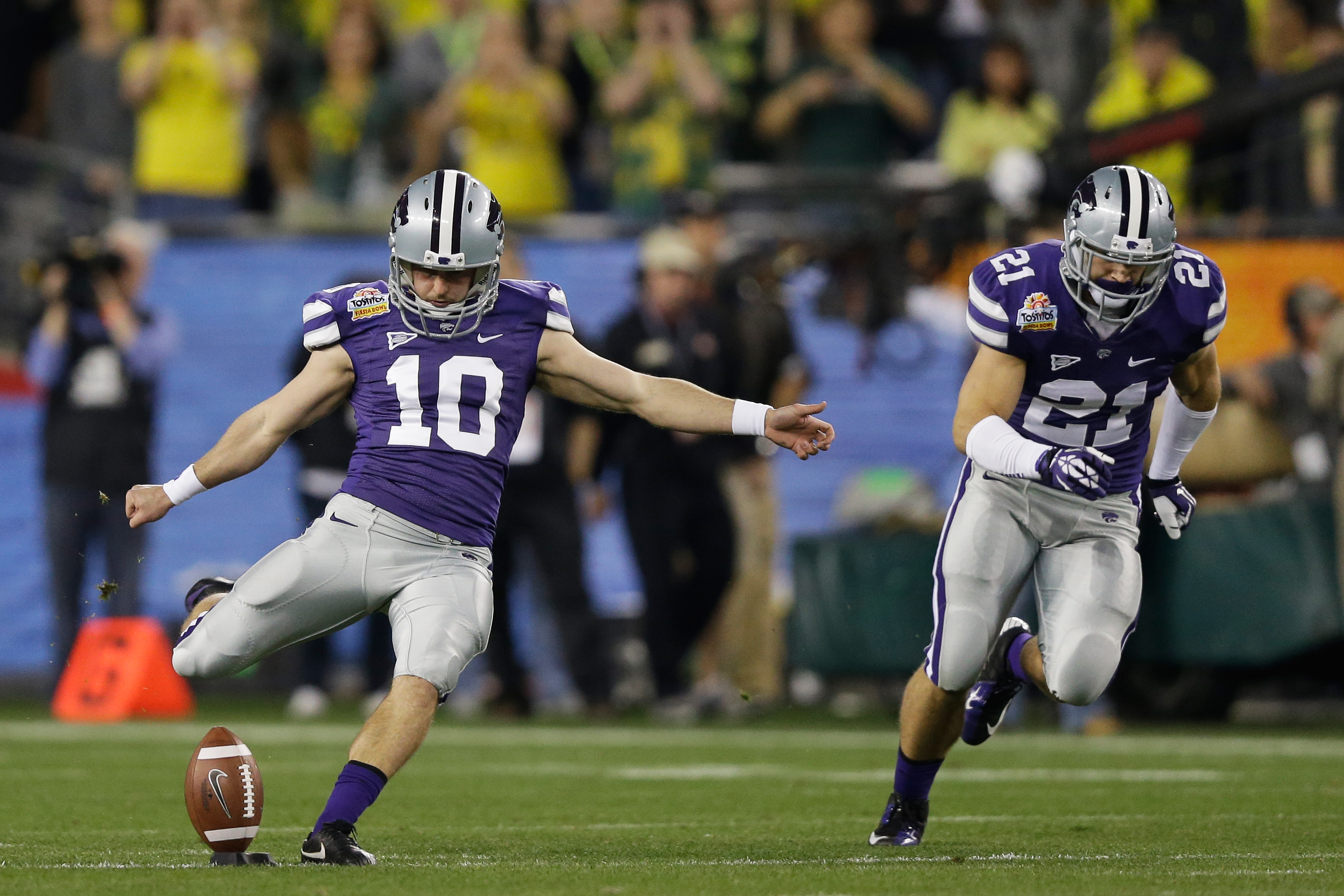 Anthony Cantele was a great kicker for Kansas State. Now he is coach to the next great kicker, Blake Lynch, who will inherit Cantele's No. 10.