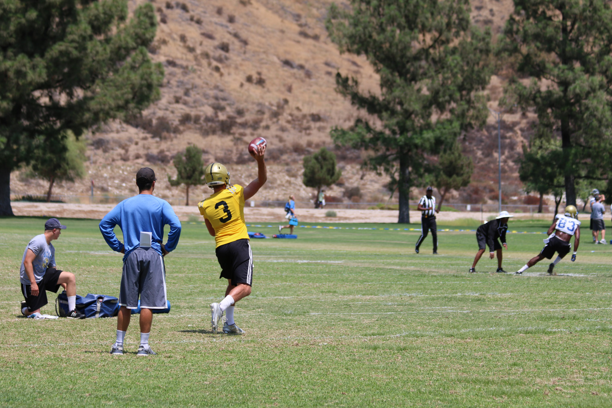 Josh Rosen throws the ball as receiver Alex Van Dyke makes a cut to come back for the ball.