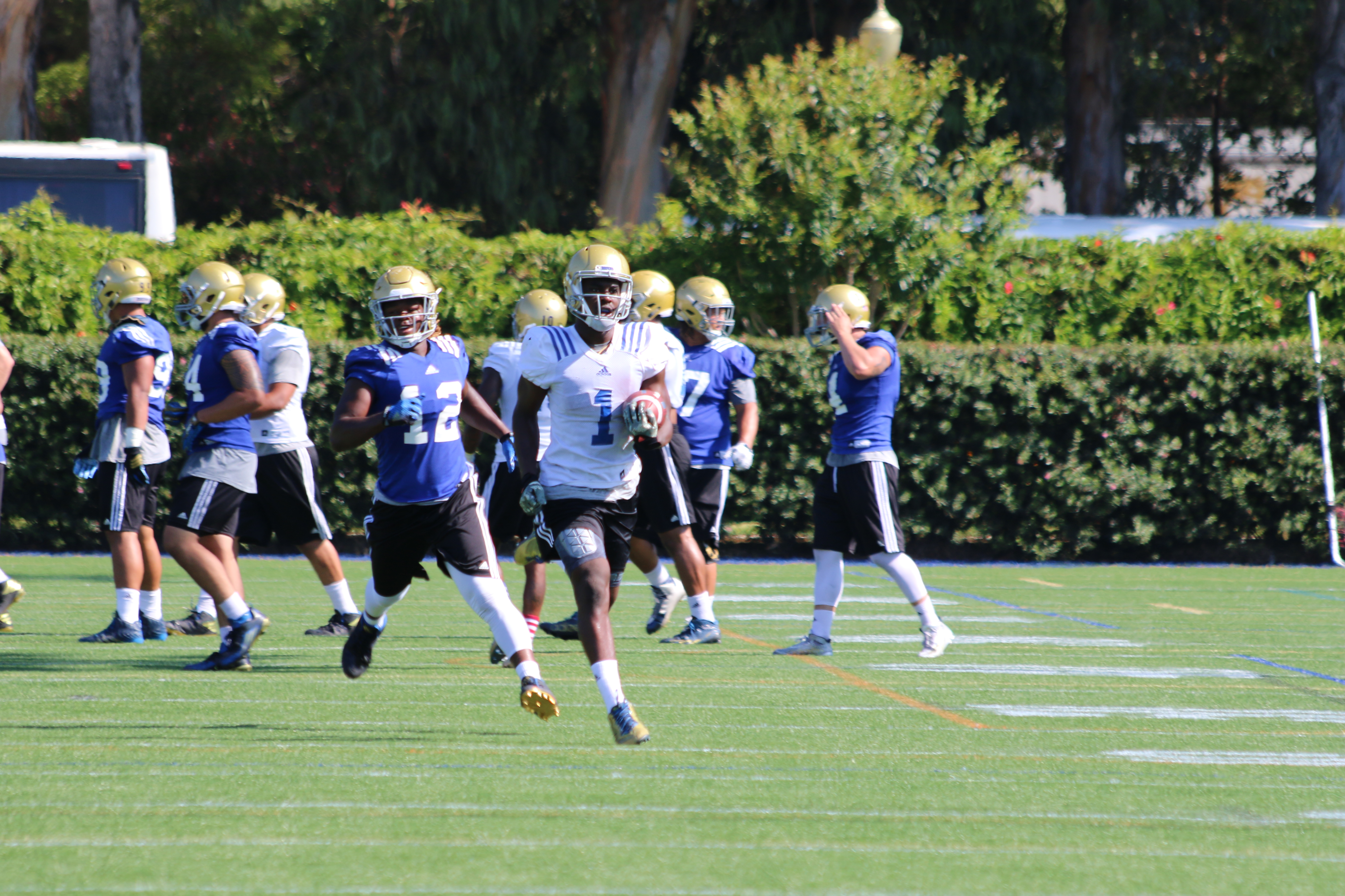 Soso Jamabo gets past Jayon Brown during practice during Fall Camp in Westwood.