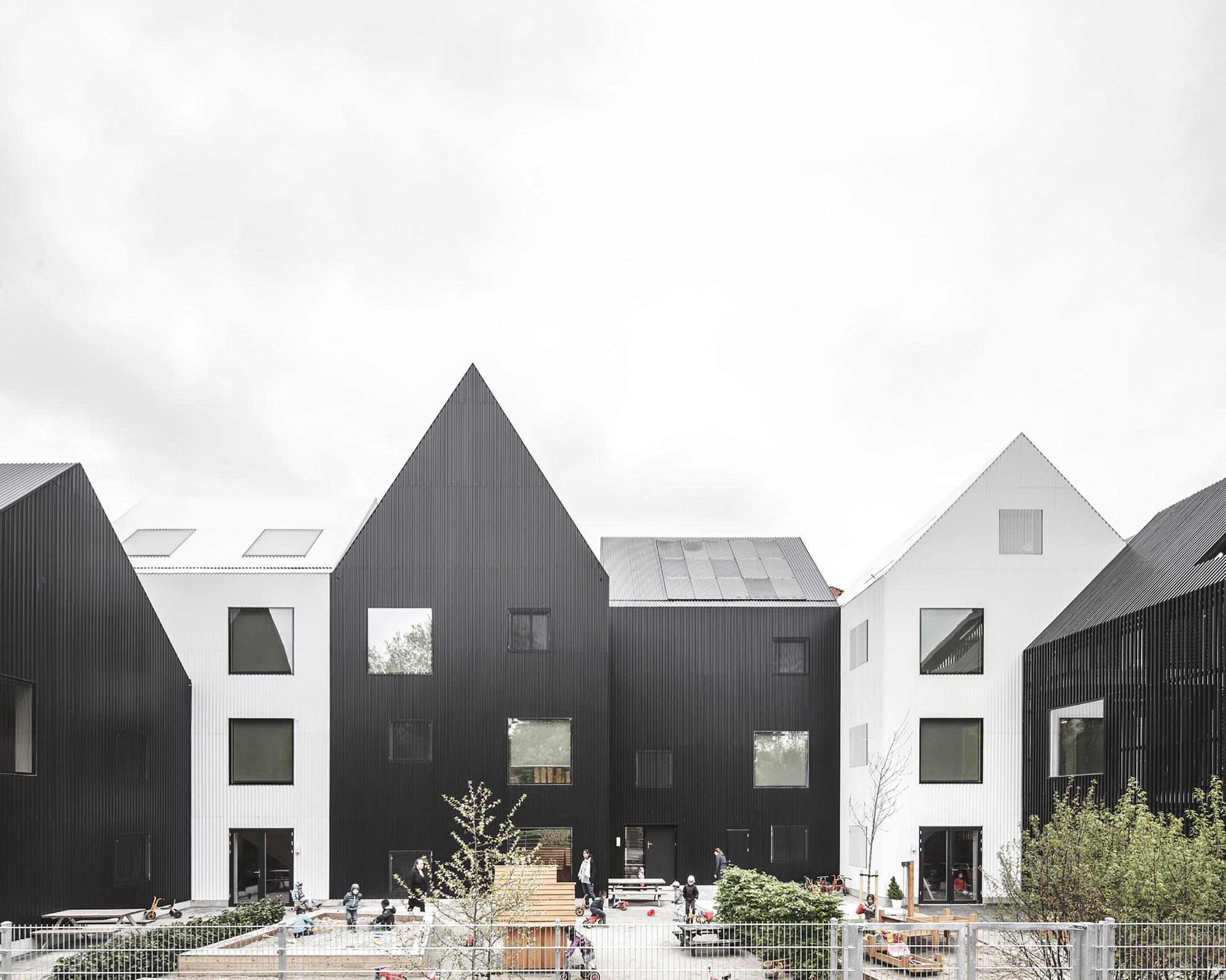 black and white gabled volumes for a Danish kindergarten