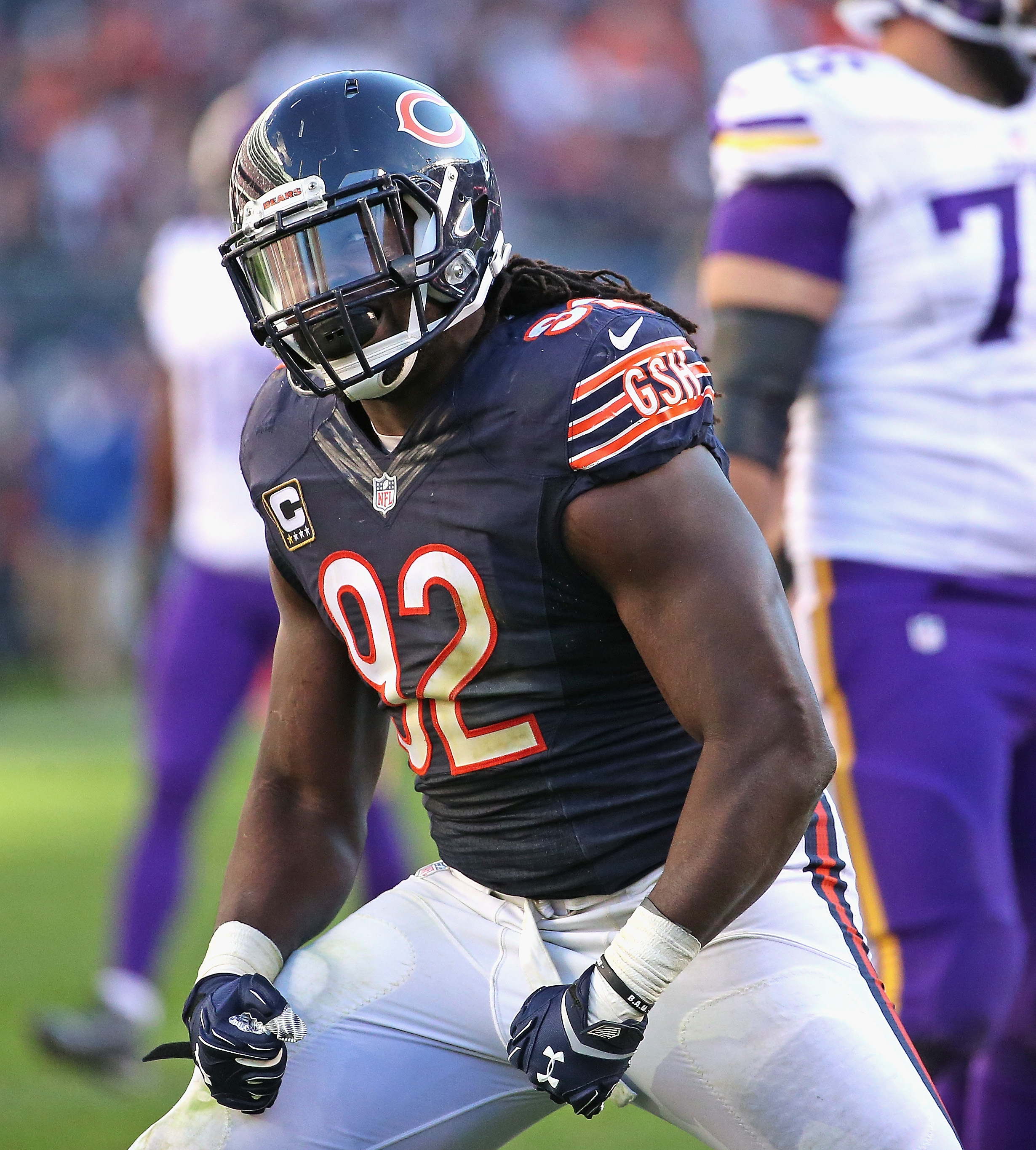 Pernell McPhee flexes his muscles after a huge play