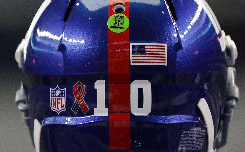 Eli Manning's helmet includes a 9/11 sticker.