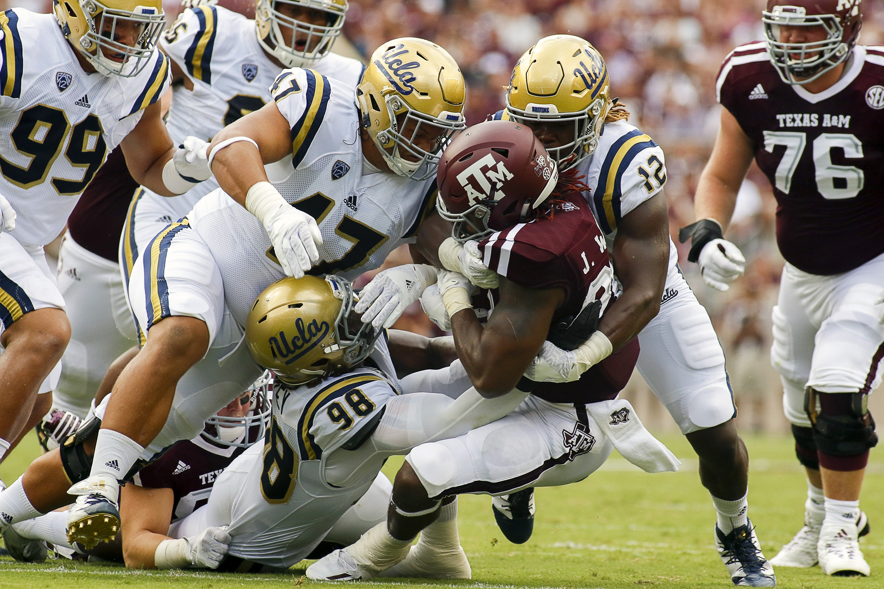 Takkarist McKinley was injured early in the game at Texas A&M.