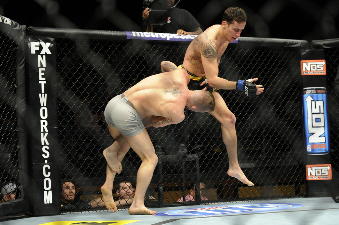 Colton Smith (left) works for a takedown against Mike Ricci (right) at the TUF 16 Finale last night