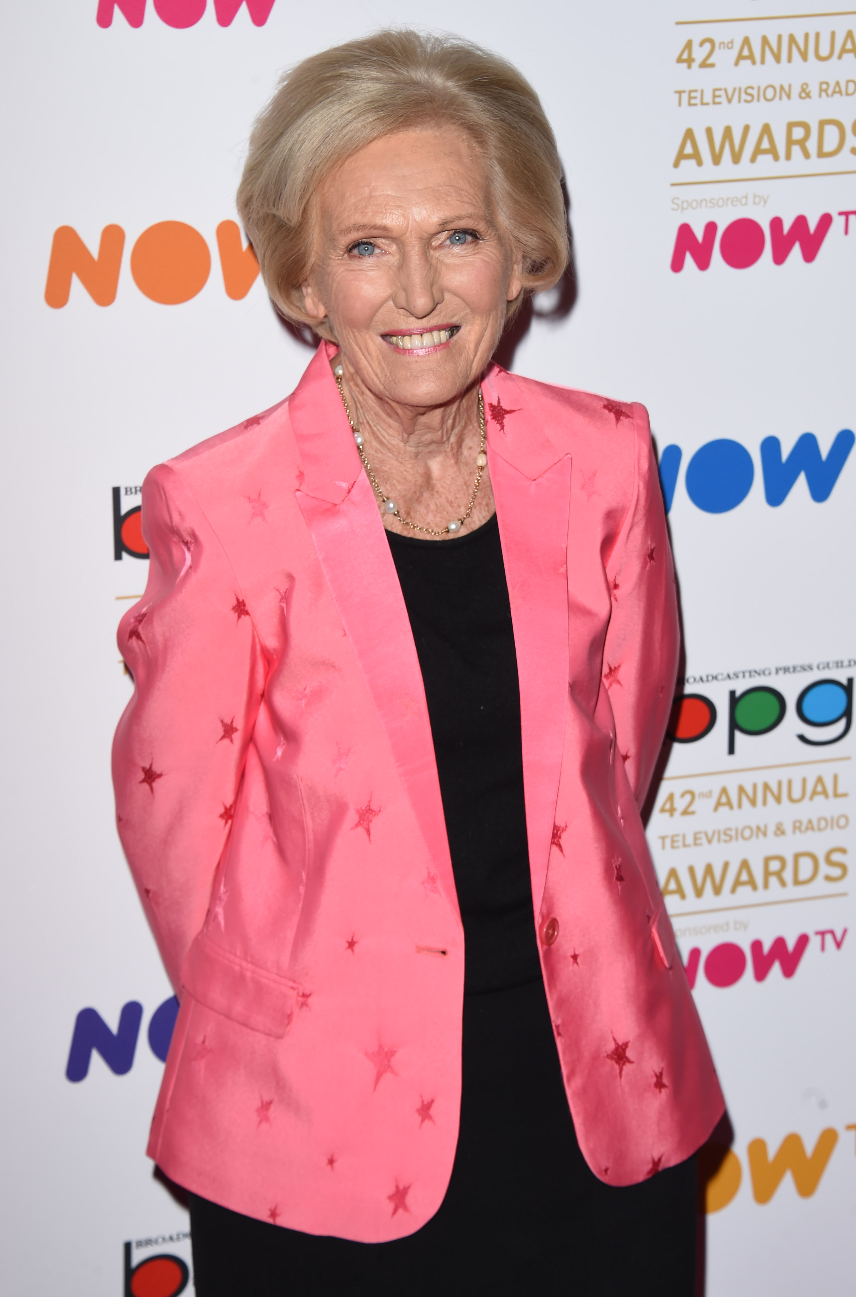 Mary Berry attending an awards show in a pink suit