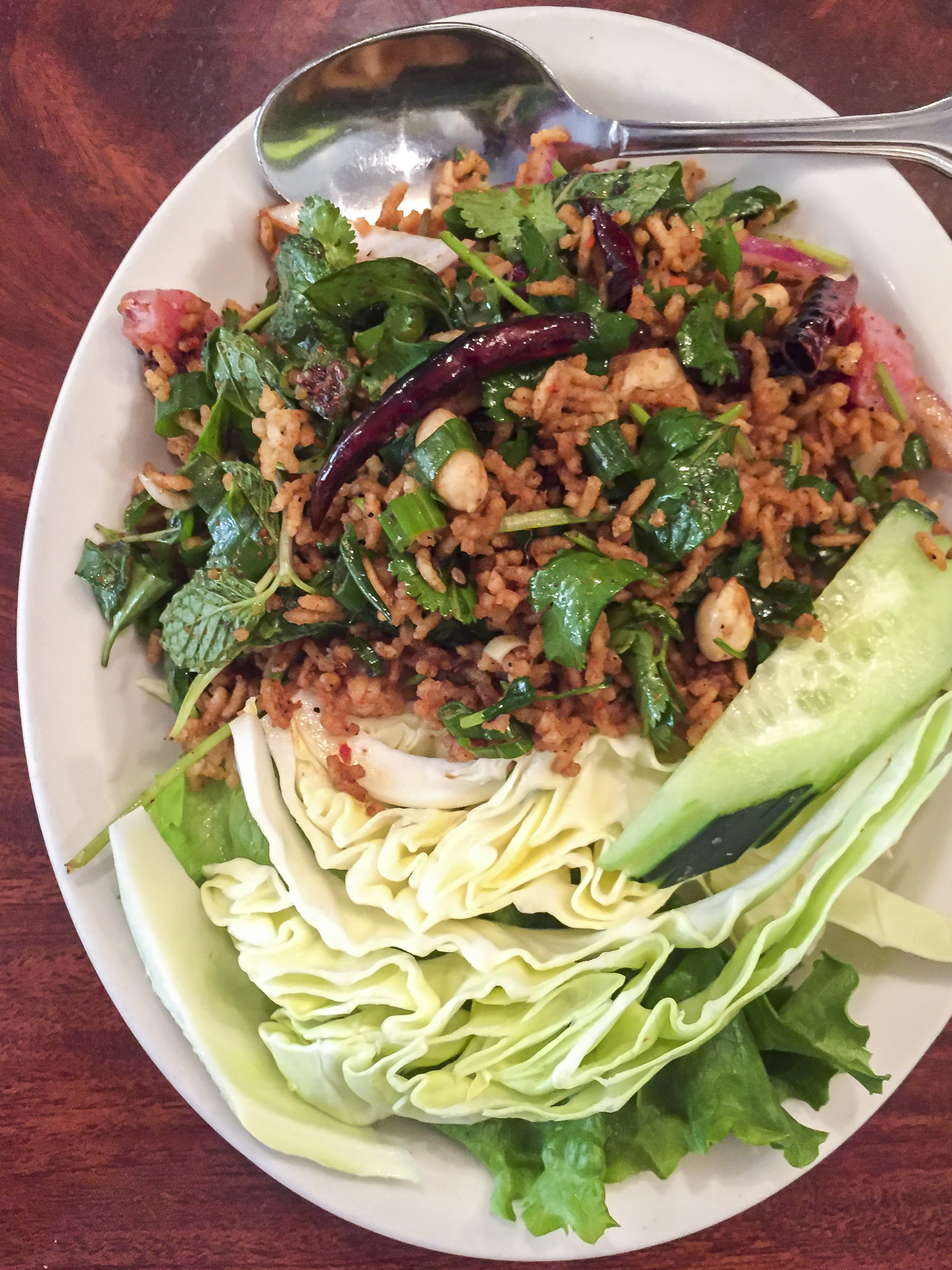 A close up image of a plate of Nam Kao Tod