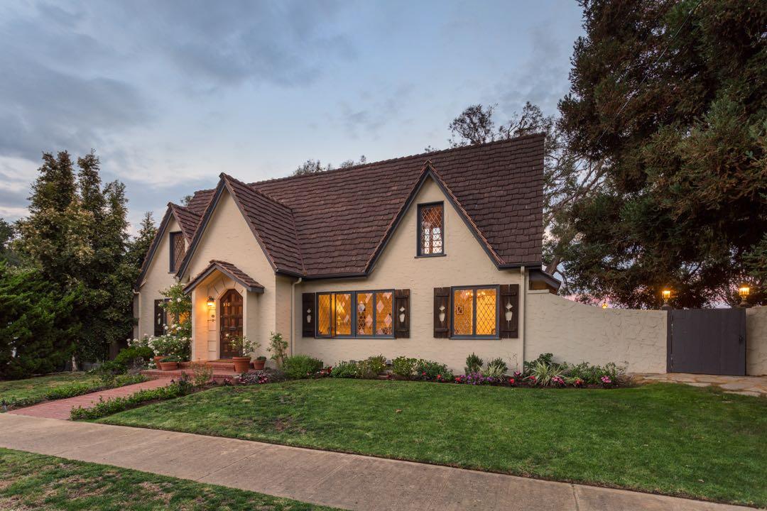 White English-style home with diamond-paned windows