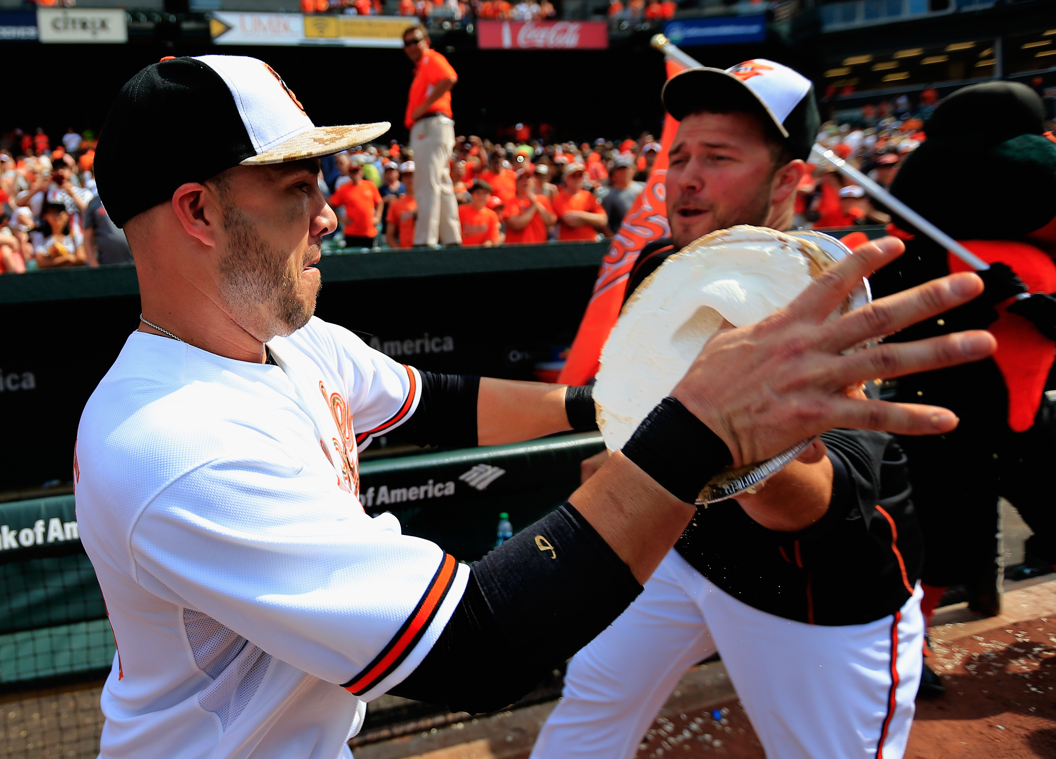 Tommy Hunter hits Steve Pearce in the face with a pie after a game in 2015.