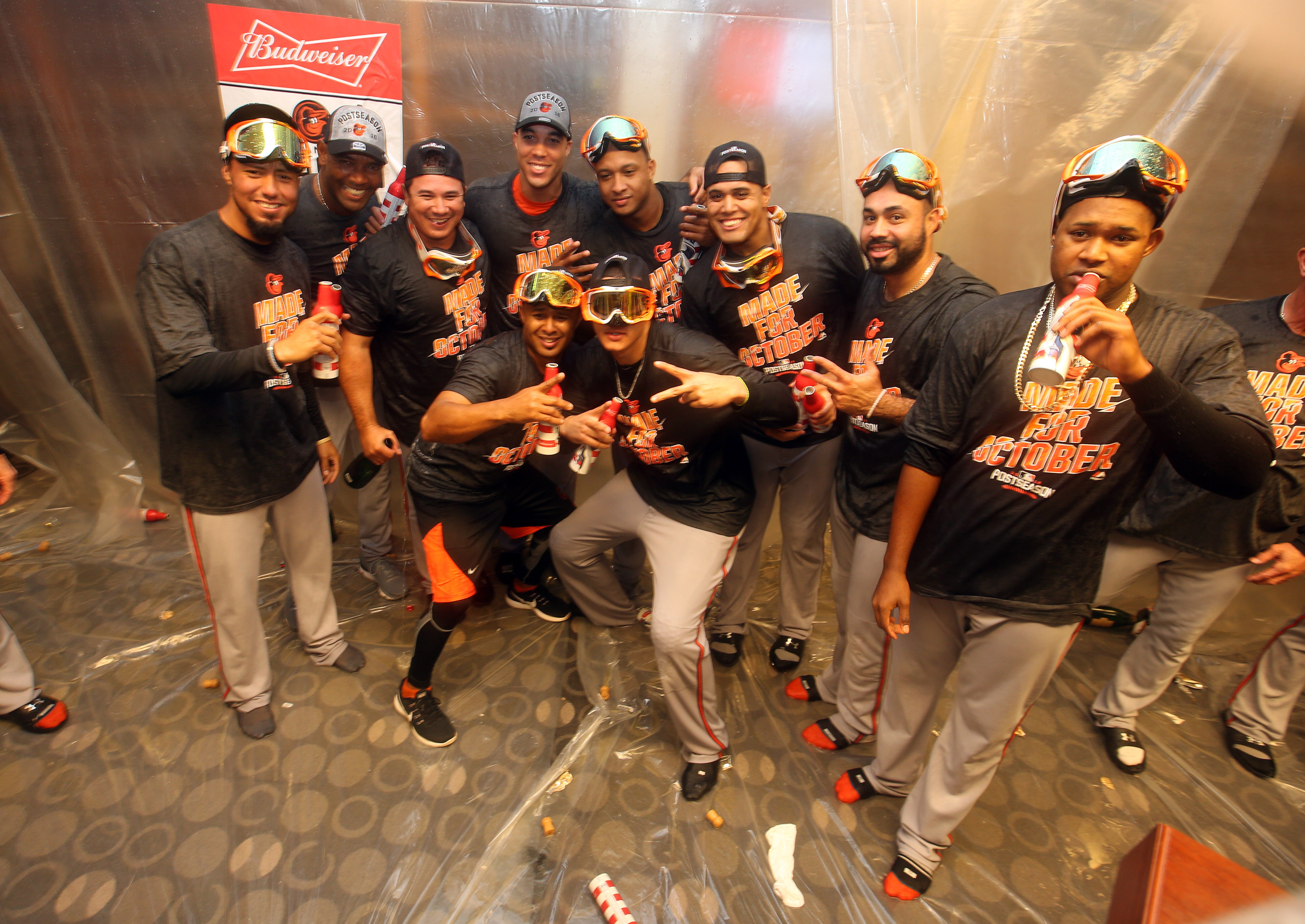 A number of Orioles players celebrate clinching a postseason spot.