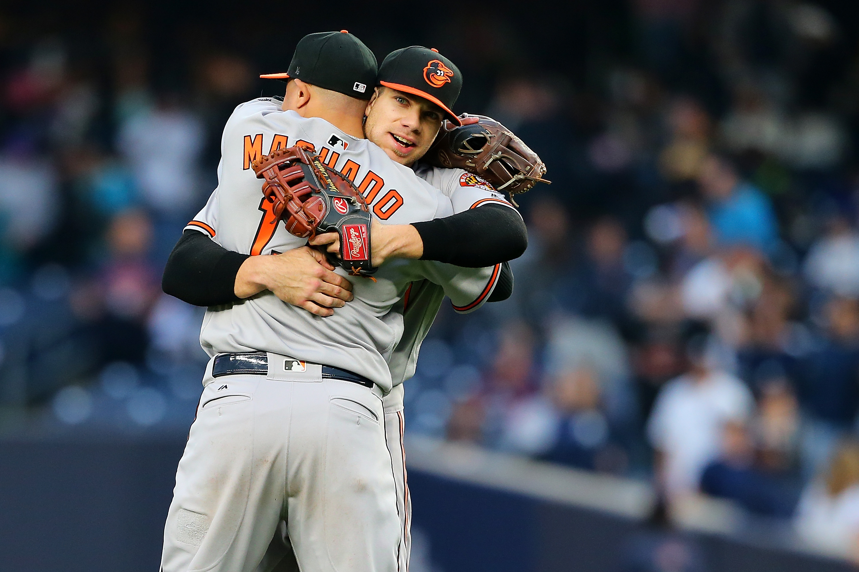Manny Machado and Chris Davis hug one another after the Orioles clinch a postseason berth.