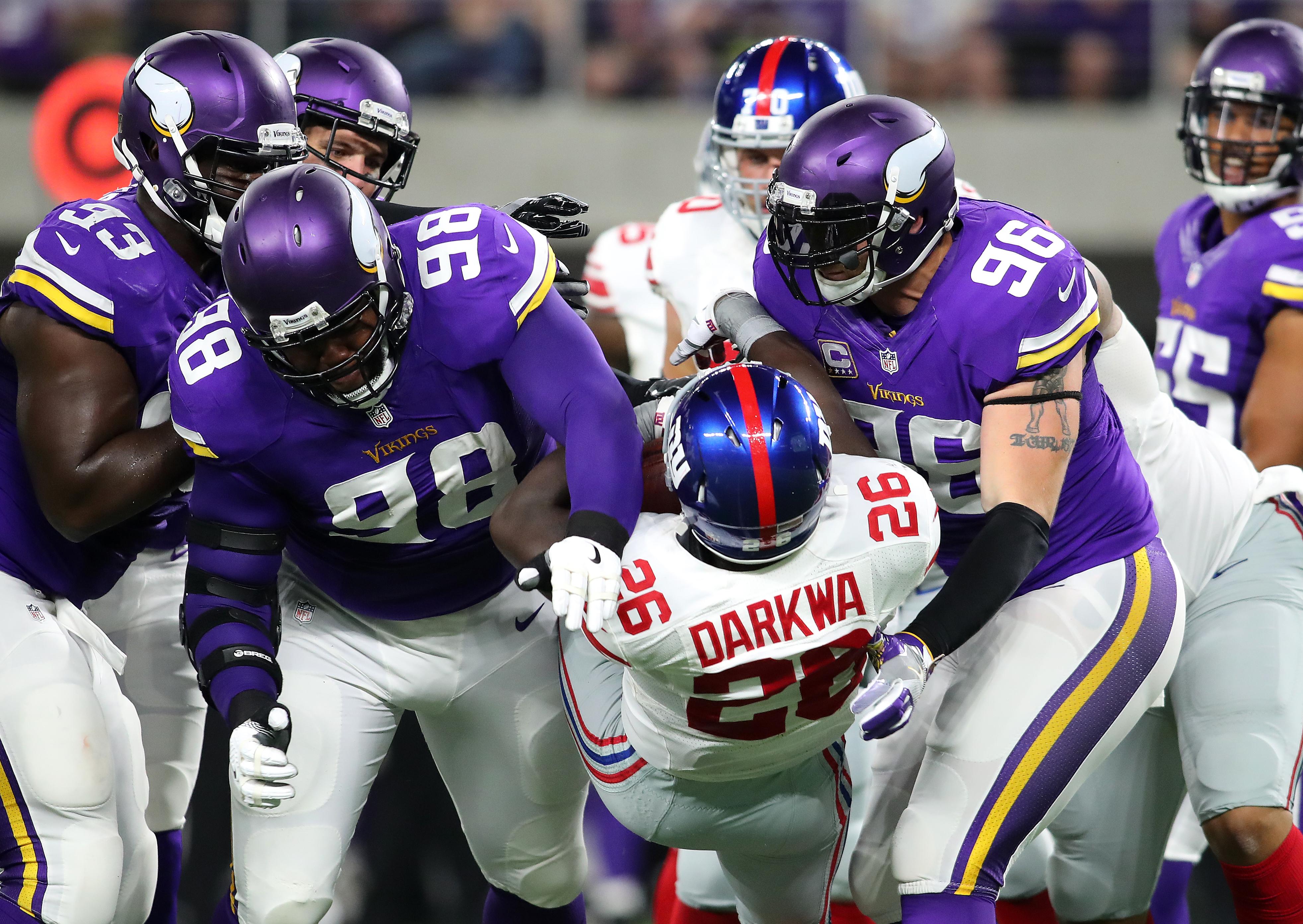 Orleans Darkwa rudely tackled by Minnesota defenders