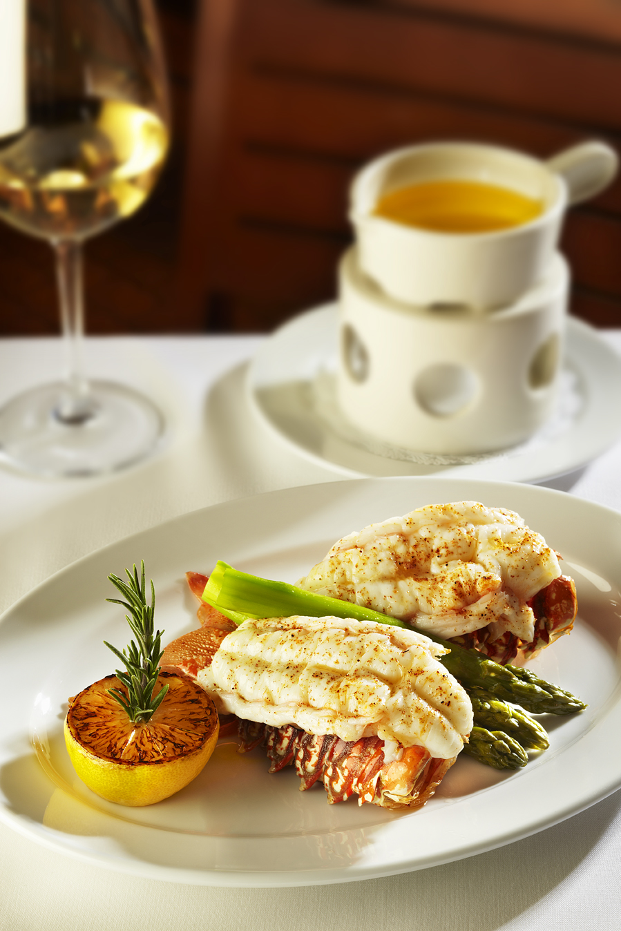 Ocean Prime's twin lobster tails with asparagus and drawn butter for $49
