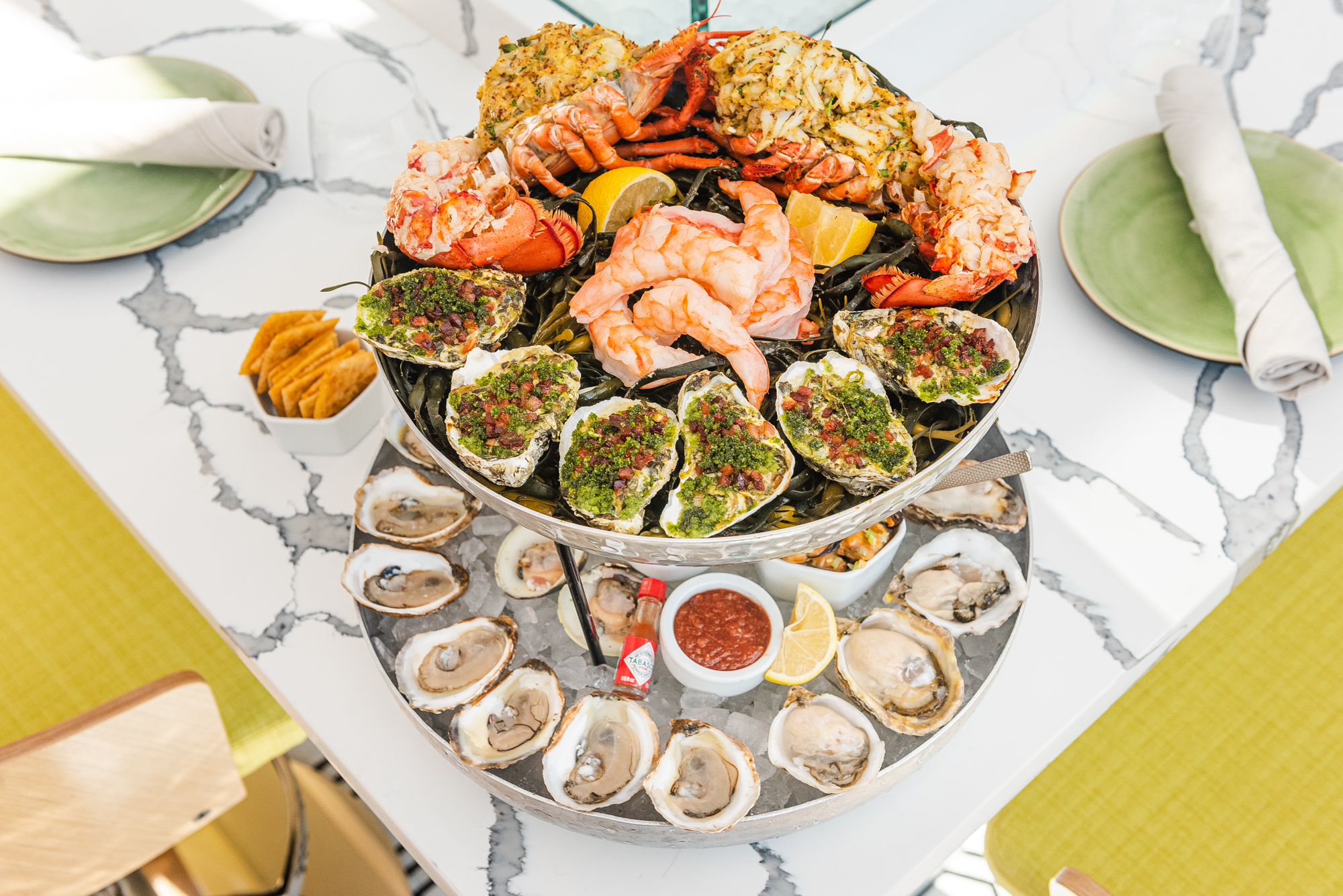 "The Imperial tower ($144) comes with 18 oysters, eight clams, six shrimp, smoked mussels, oysters rockefeller, whole lobster. and blue crab ""Imperial"""