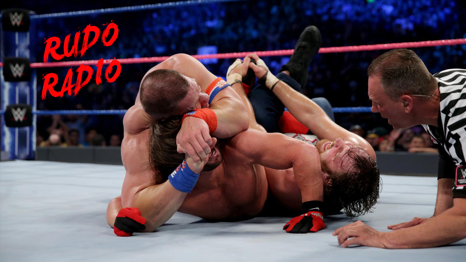 John Cena and Dean Ambrose both attempt to submit AJ Styles at the same time.