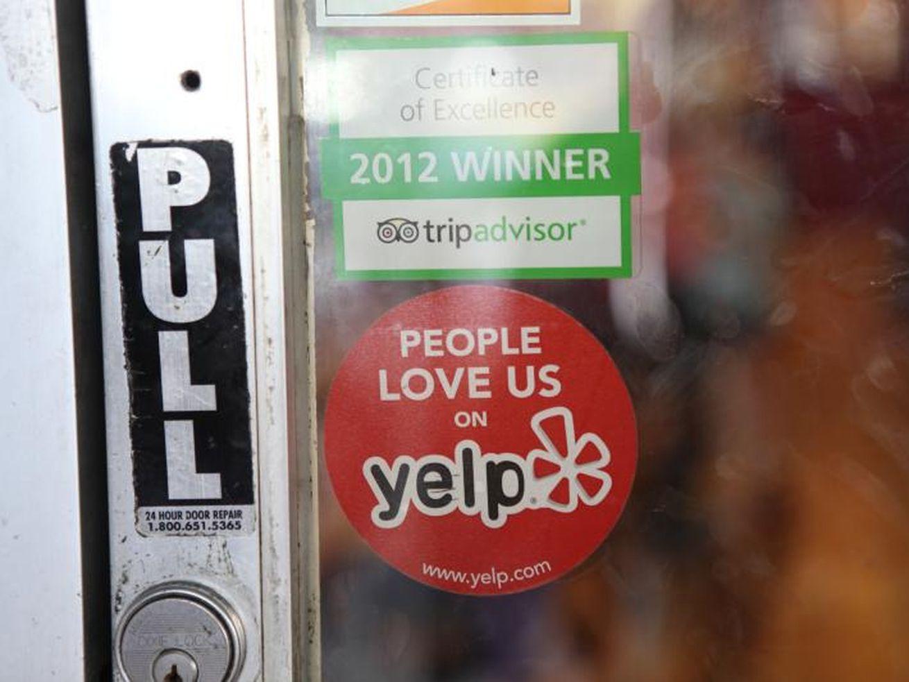 """People love us on Yelp"" window sticker"