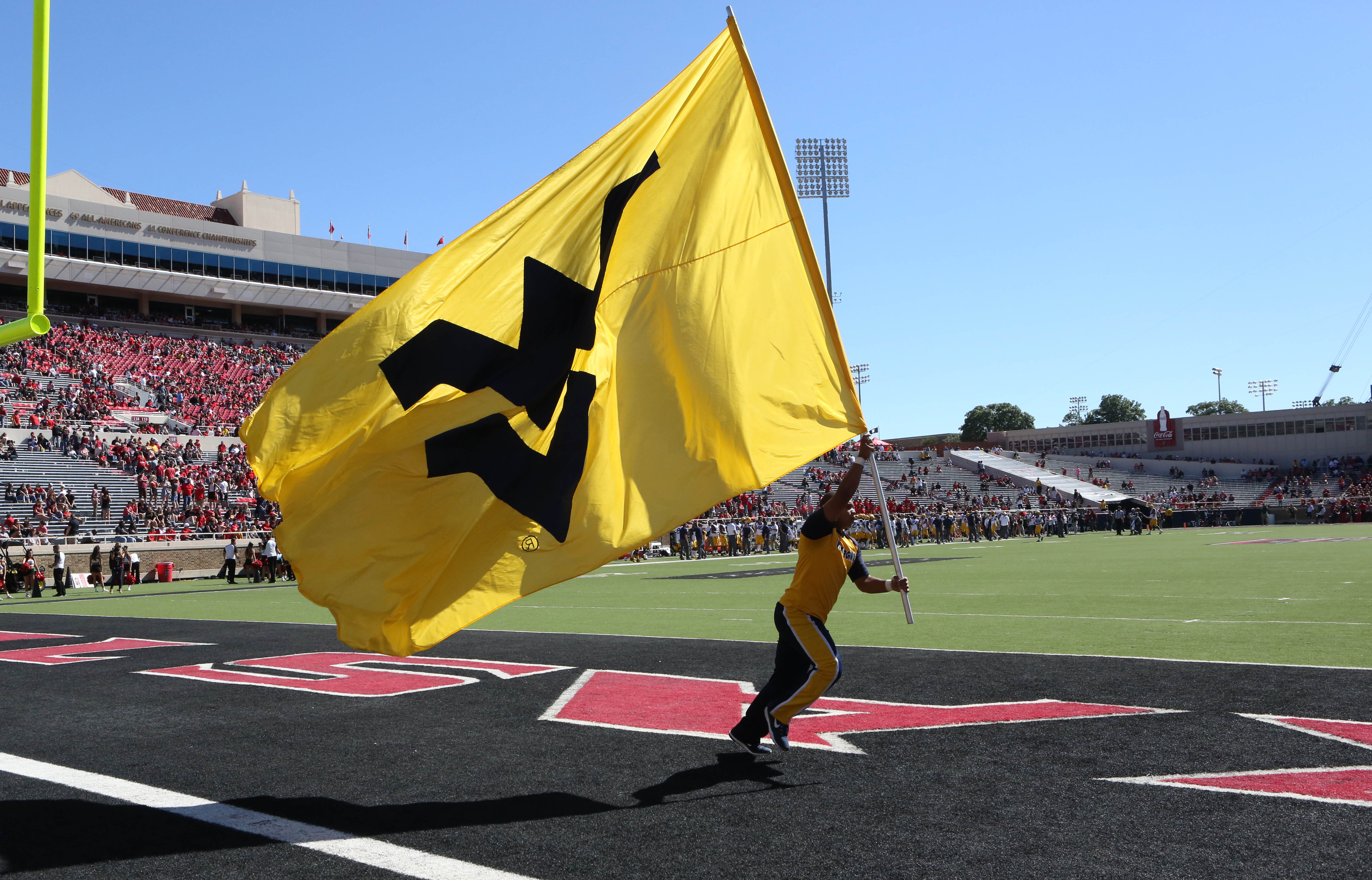 West Virginia fans are happy today as they moved up substantially in both polls.