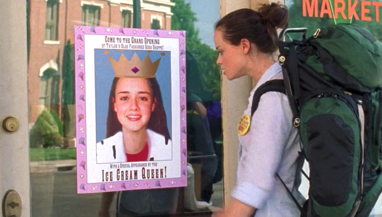 A scene from Gilmore Girls: Rory sees Taylor Doose's sign announcing her has ice cream queen.