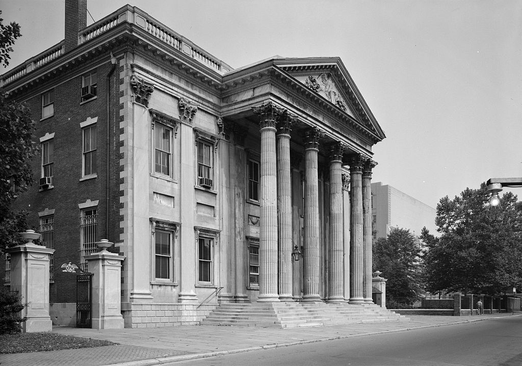 A large house with columns on the facade.