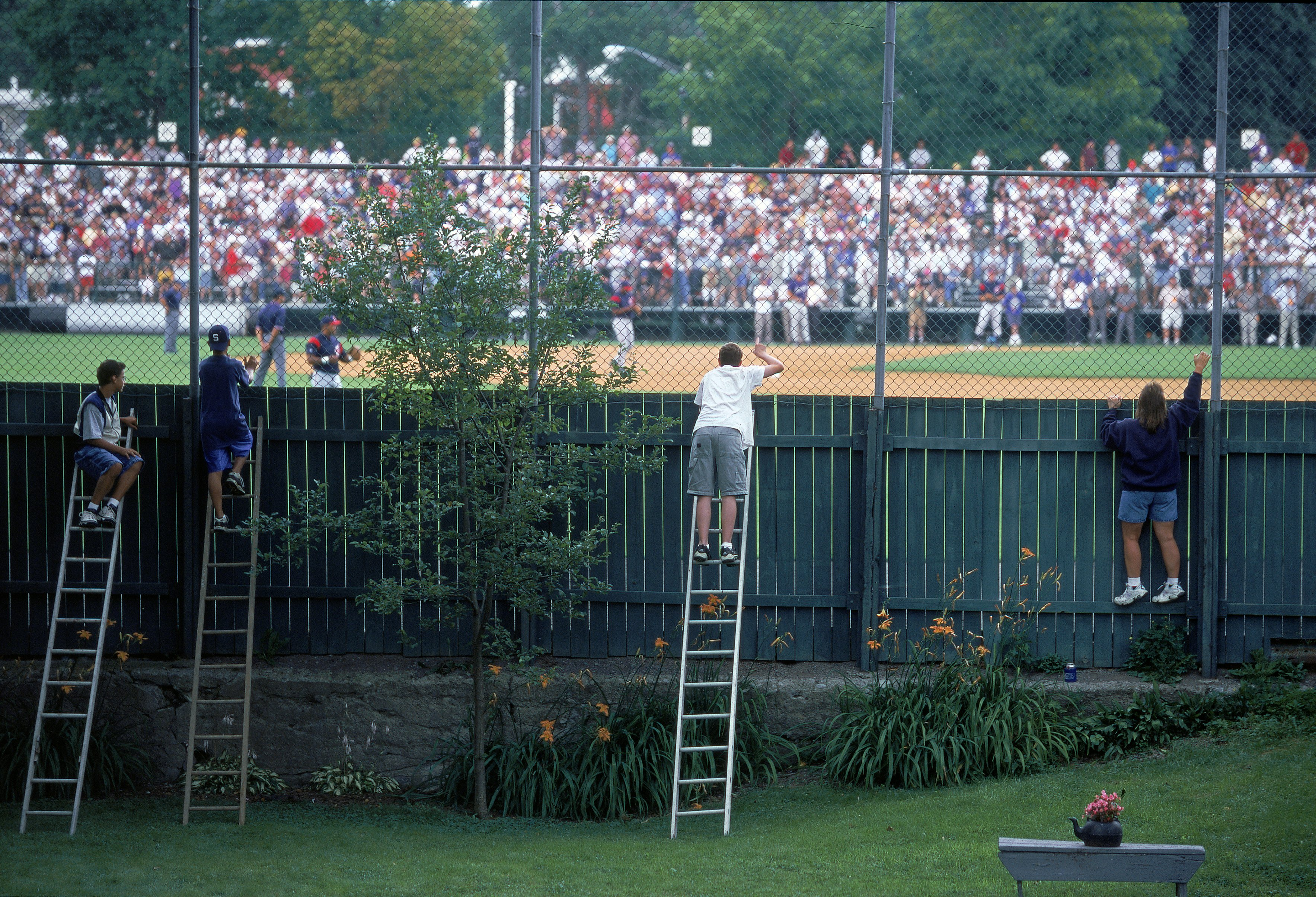 Fans Standing on Ladders